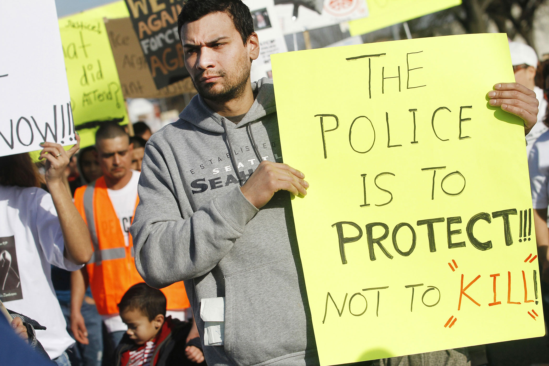 A demonstrator marches during a rally for Antonio Zambrano-Montes on  Feb. 14, 2015, in Pasco, Wash.
