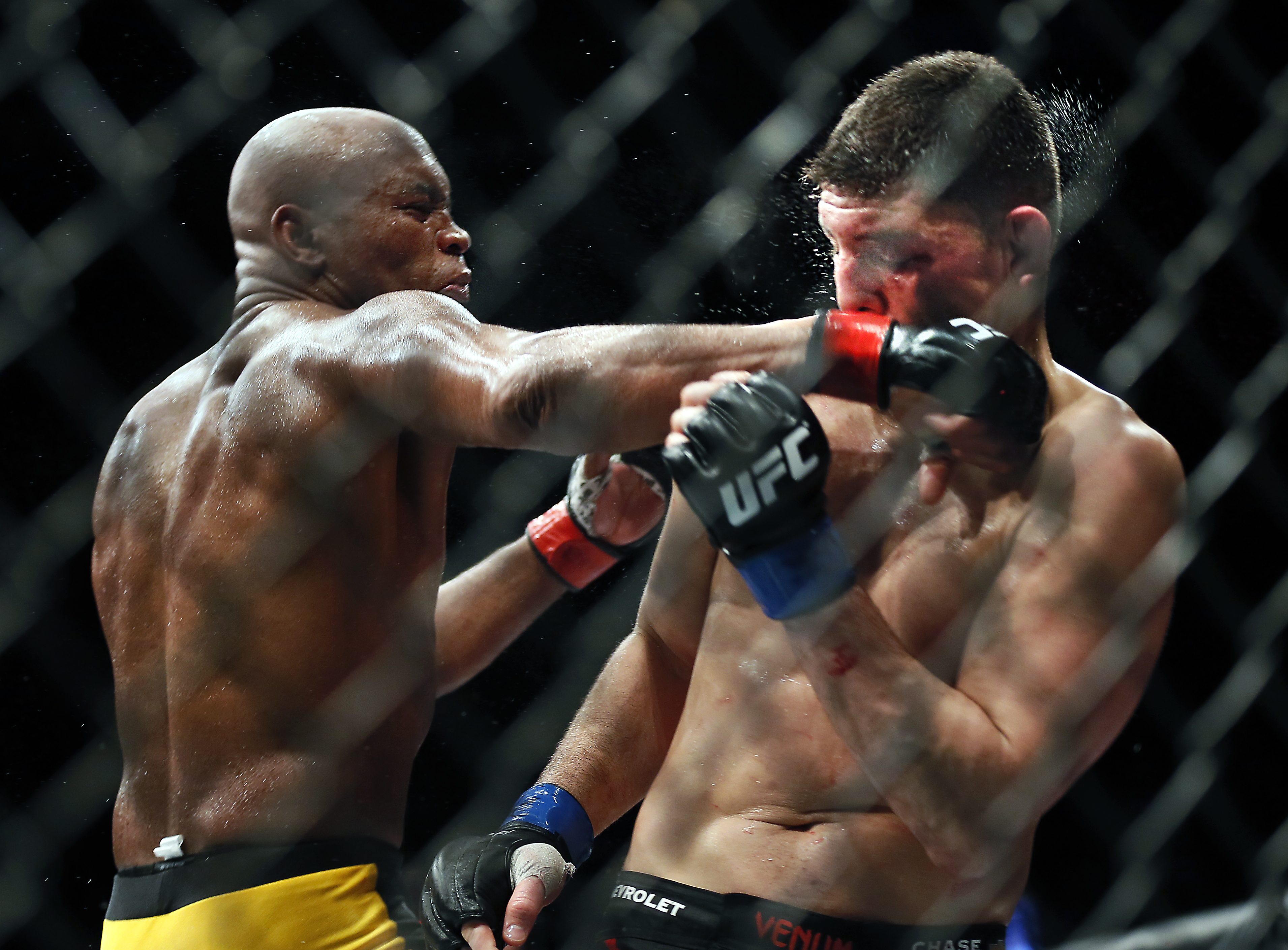 Middleweight Anderson Silva punches Nick Diaz during their fight at the MGM Grand Garden Arena in Las Vegas on Saturday, Jan. 31, 2015