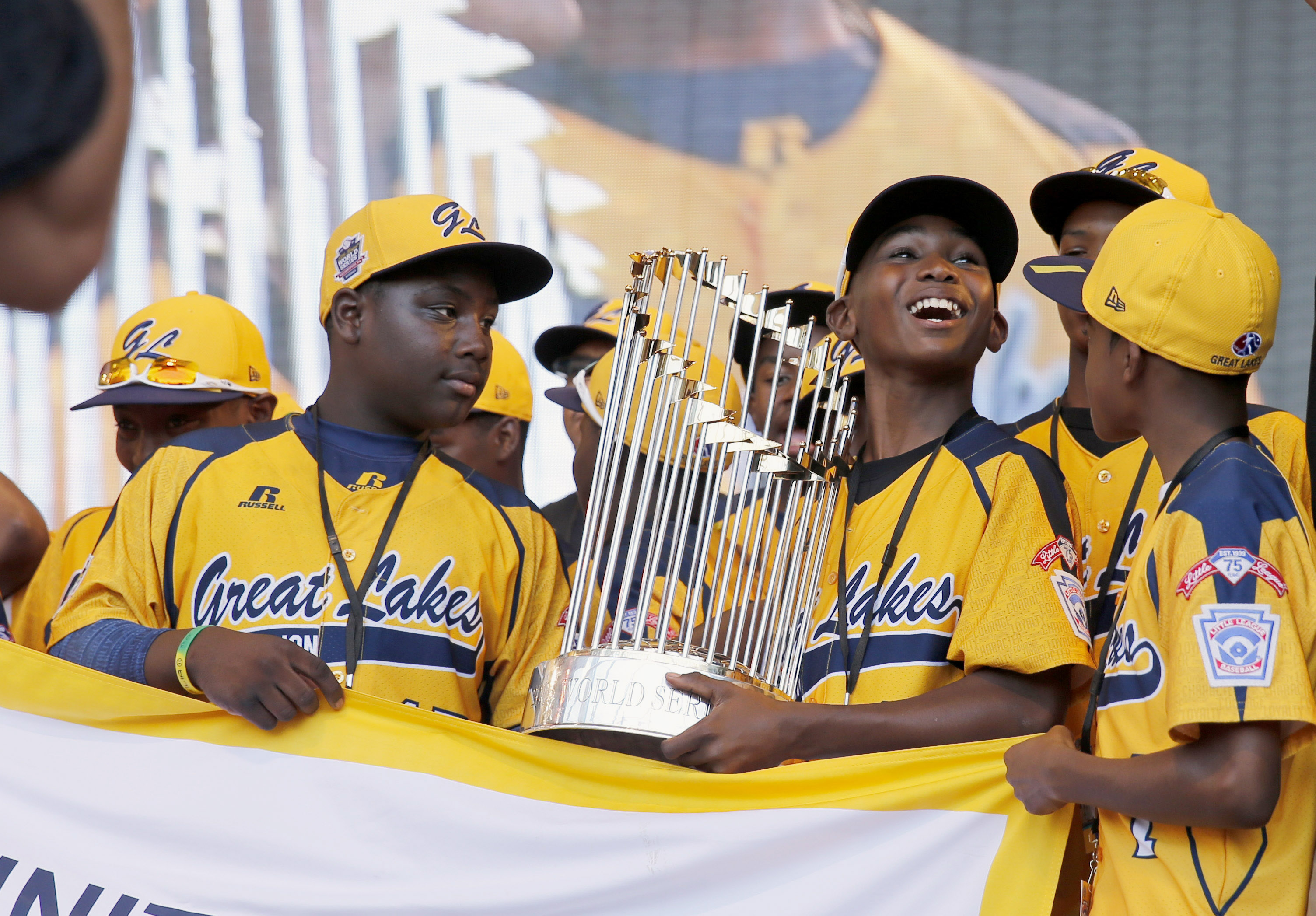 Members of the Jackie Robinson West Little League baseball team participate in a rally in Chicago celebrating the team's U.S. Little League Championship. on Aug. 27, 2014.