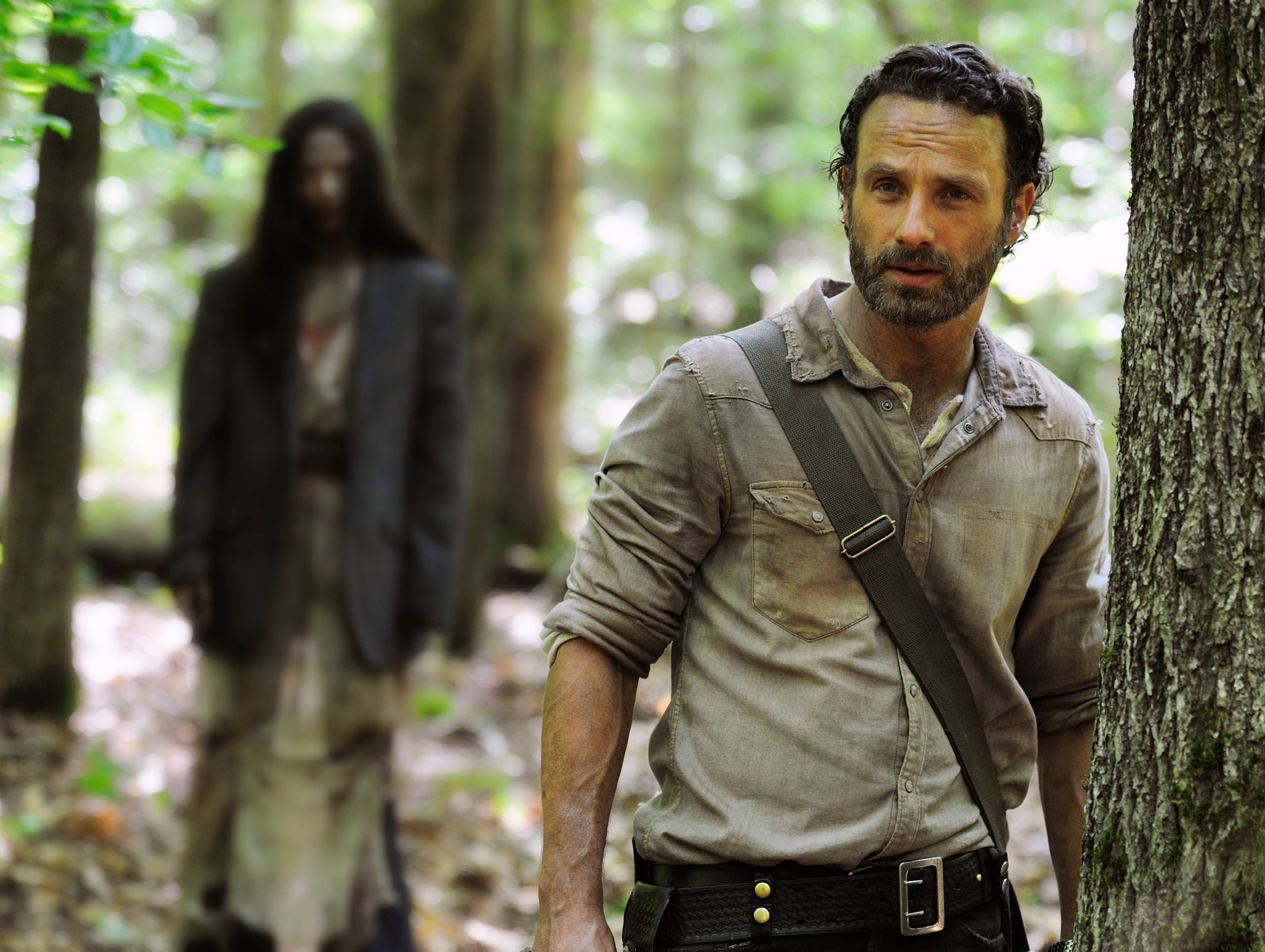 Andrew Lincoln as Rick Grimes in a scene from the season four premiere of  The Walking Dead.