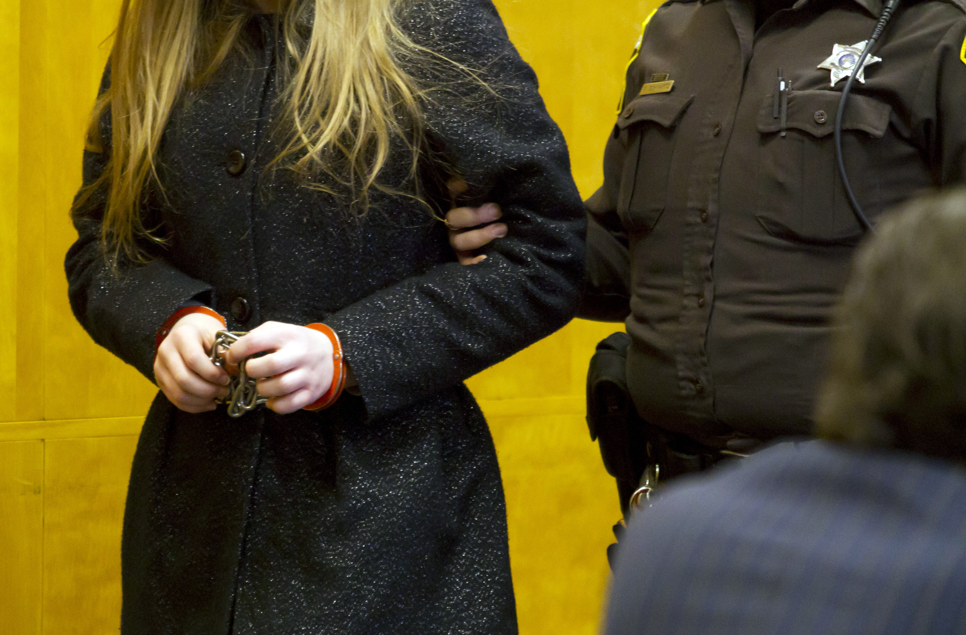One of two 12-year-old girls accused of stabbing a classmate to please the fictional character Slender Man is led into a courtroom at the Waukesha County Courthouse in Waukesha, Wis., on Nov. 18, 2014