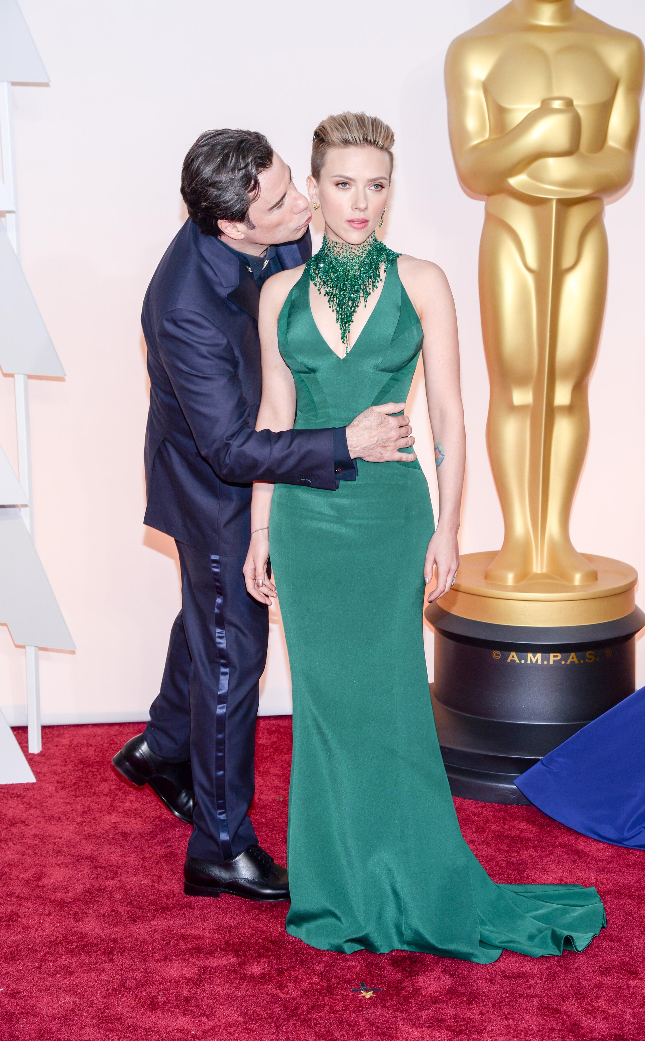 John Travolta (L) and Scarlett Johansson (R) at the 87th Annual Academy Awards in Hollywood, Calif. on Feb. 22, 2015.