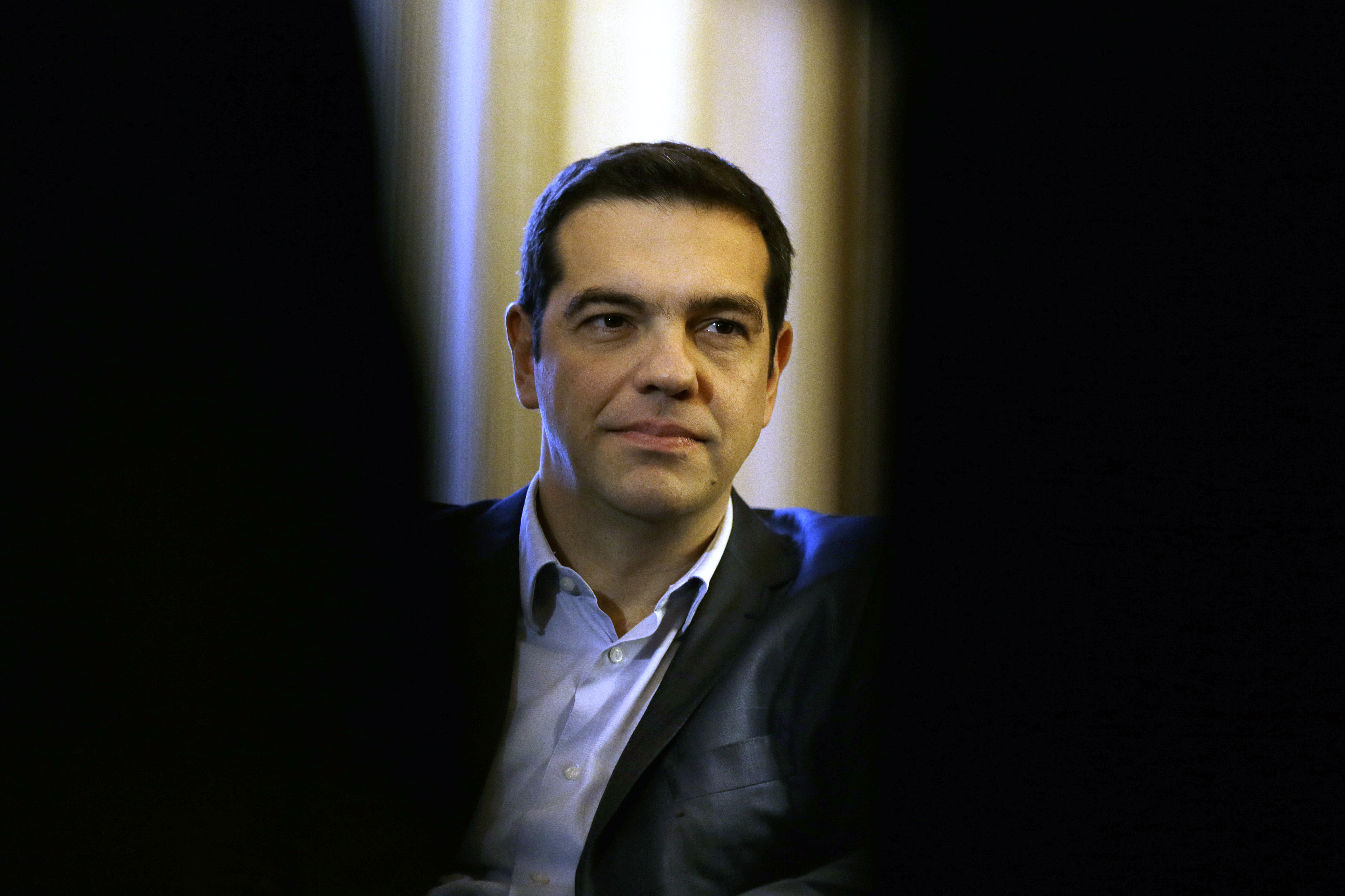 Greece Prime Minister Alexis Tsipras listens to Greek President Karolos Papoulias during their meeting at Presidential Palace in Athens, Greece on Feb. 18, 2015.