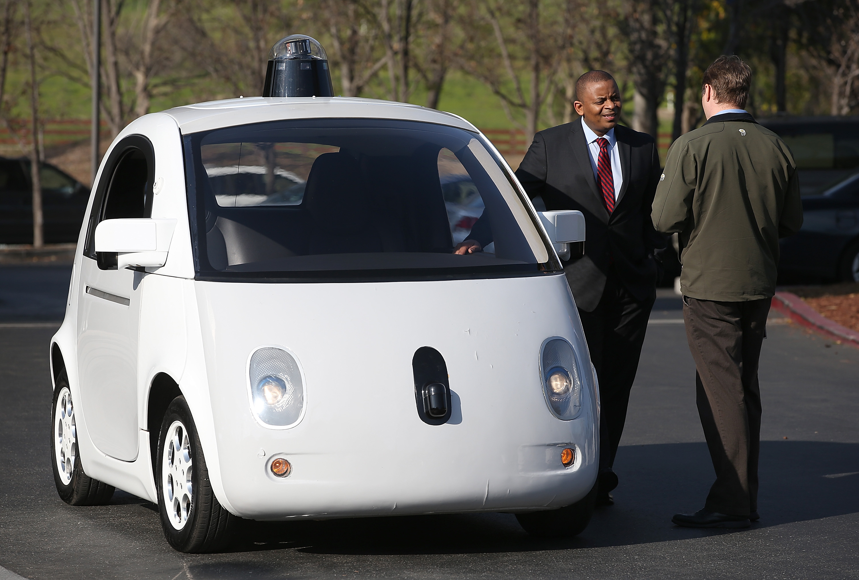 U.S. Transportation Secretary Anthony Foxx inspects a Google self-driving car at the Google headquarters on Feb. 2, 2015 in Mountain View, Calif.