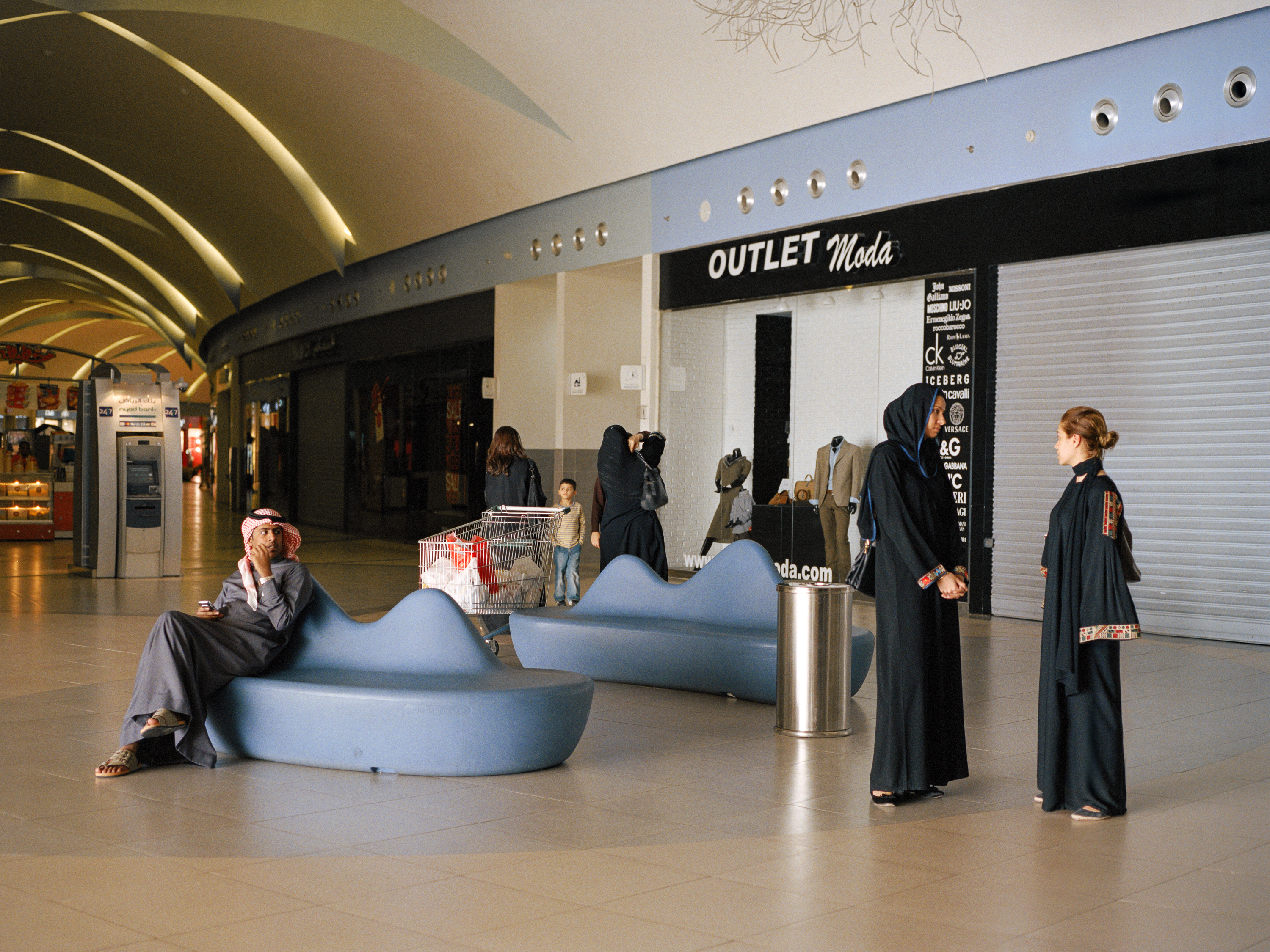 Dhahran Mall, a 10 minute drive outside of the compound. Women usually wear abayas outside of Aramco's compound.