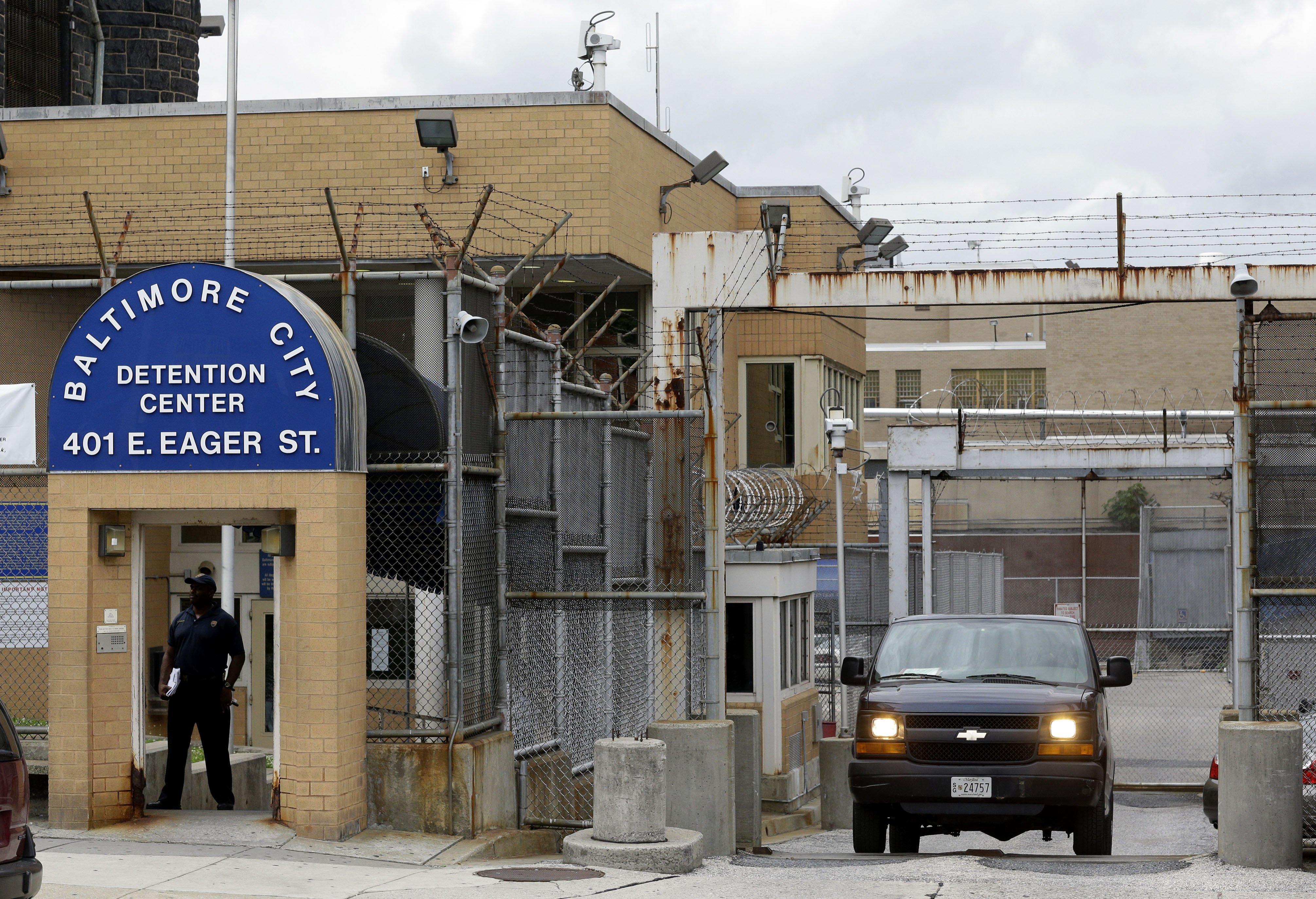 An inmate transport van departs from the Baltimore City Detention Center in Baltimore on June 6, 2013.