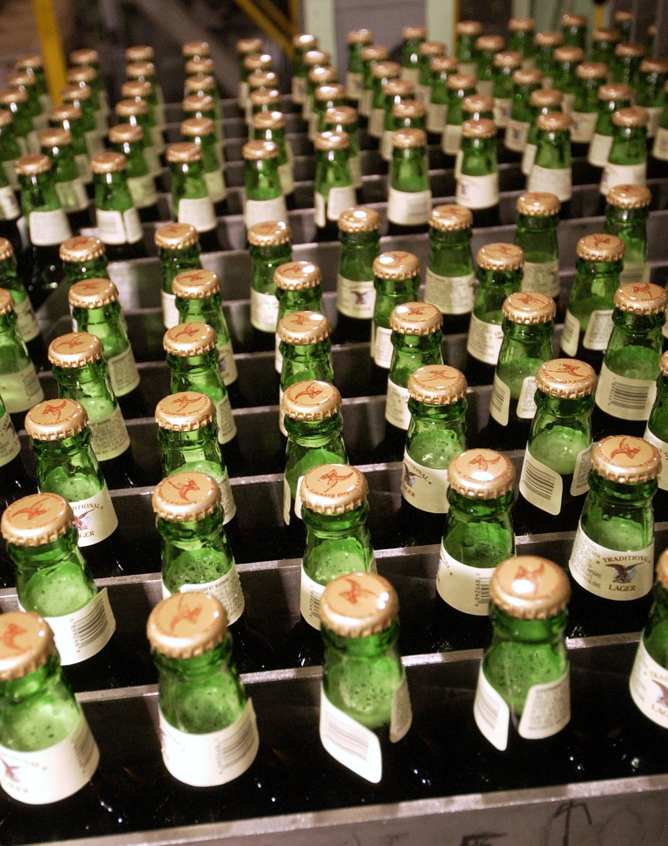 Full bottles of lager await to be loaded into cases at the Yuengling brewery in Pottsville, Pennsylvania on June 29, 2005.