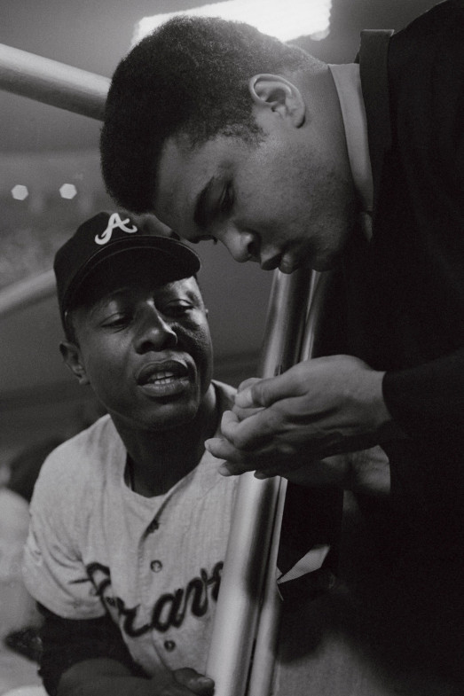 """Atlanta Braves outfielder Hank Aaron and Ali in Los Angeles, 1969                               George Washington: """"Two African-American sports icons showing the ultimate respect for the work and achievements of the other by exchanging autographs in this July 8, 1969, image taken in Los Angeles.  Hammerin' Henry Aaron, raised in the deep South, overcame tremendous racism to become baseball's home-run king. In many circles, folks believe his mark of 755 is still the best of all time. On the subject of all-time, while Aaron delivered his message with his bat, Muhammad Ali did it with his fists, his feet and his ability to speak out.  He is the Greatest of All Time. The most photographed man on the planet, Muhammad Ali is and was the inspiration for an entire race, and his charisma, wisdom and courage had the strength to jolt and awaken this country and the rest of the world at a time when we needed it most. This image says so much to me. It makes me proud to be an African American and helps me recognize the levels of achievement that are possible in character first, well before we get to sports.  It is my hope that one day my young children will see this picture, feel this picture and appreciate the influence that these men made on our society.""""                               George Washington is the deputy picture editor of Sports Illustrated."""