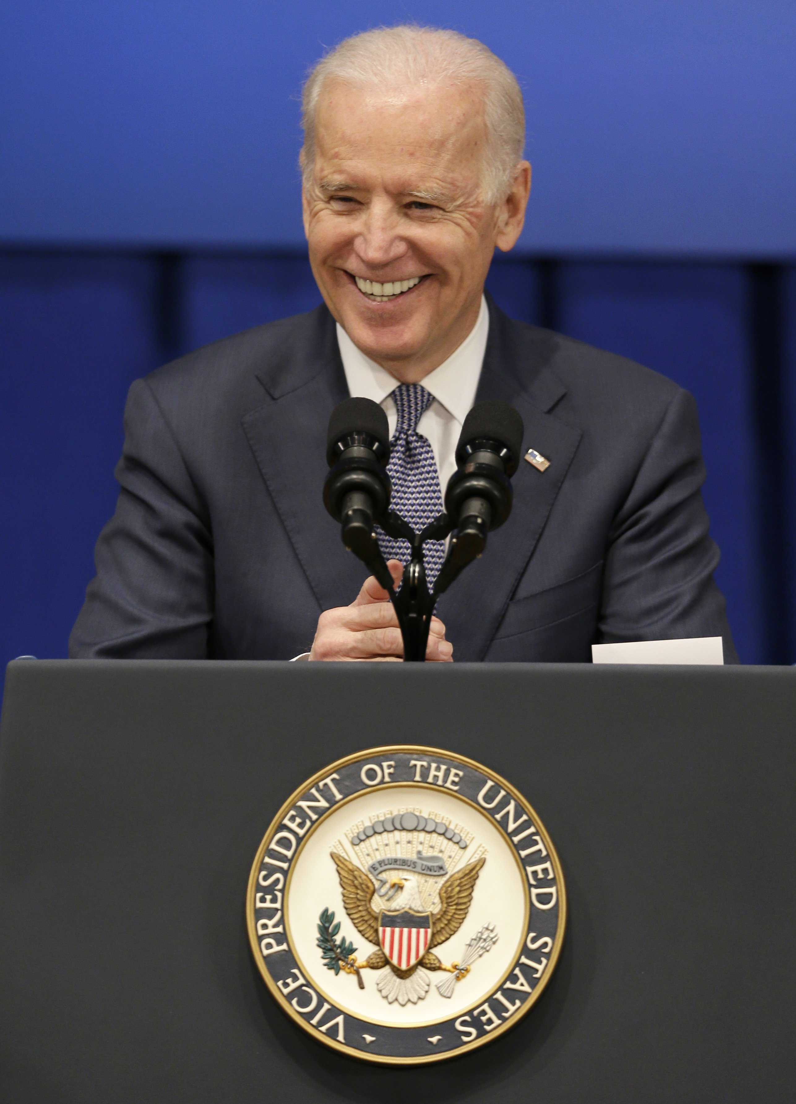 Vice President Joe Biden smiles as he speaks about the economy and the Obama administration's policies on Feb. 12, 2015, at Drake University in Des Moines, Iowa.