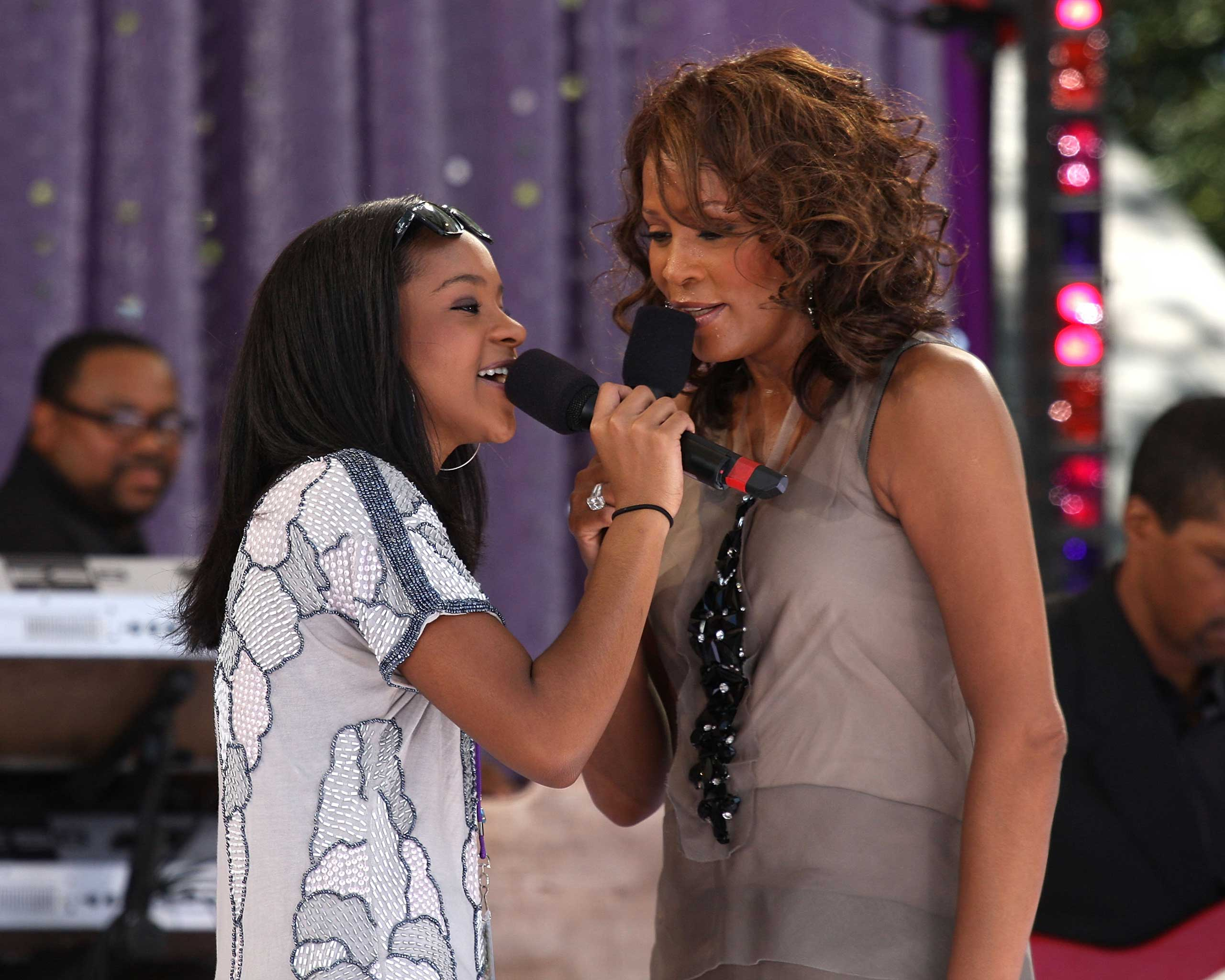 Bobbi Kristina Brown and Whitney Houston perform in Central Park on Sept. 1, 2009 in New York City.