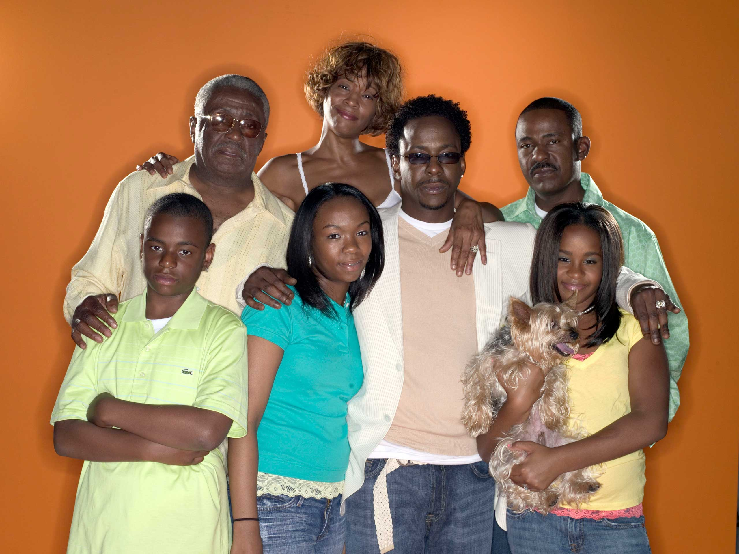 The Brown family poses for a portrait for their reality television show 'Being Bobby Brown.' Left to Right: Pops Brown, Whitney Houston, Tommy Brown, Bobby Brown Jr., La'princia Brown, Bobby Brown, Bobbi Kristina Brown.