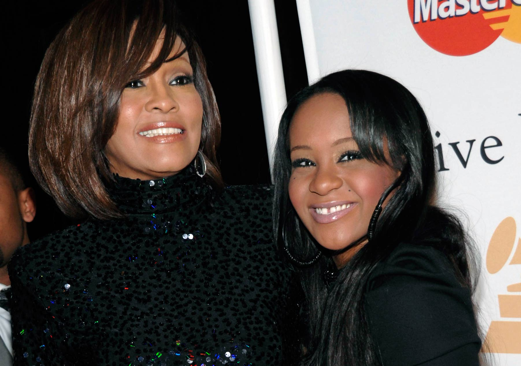 Whitney Houston, left, and her daughter Bobbi Kristina Brown arrive at an event in Beverly Hills, Calif. on Feb. 12, 2011.