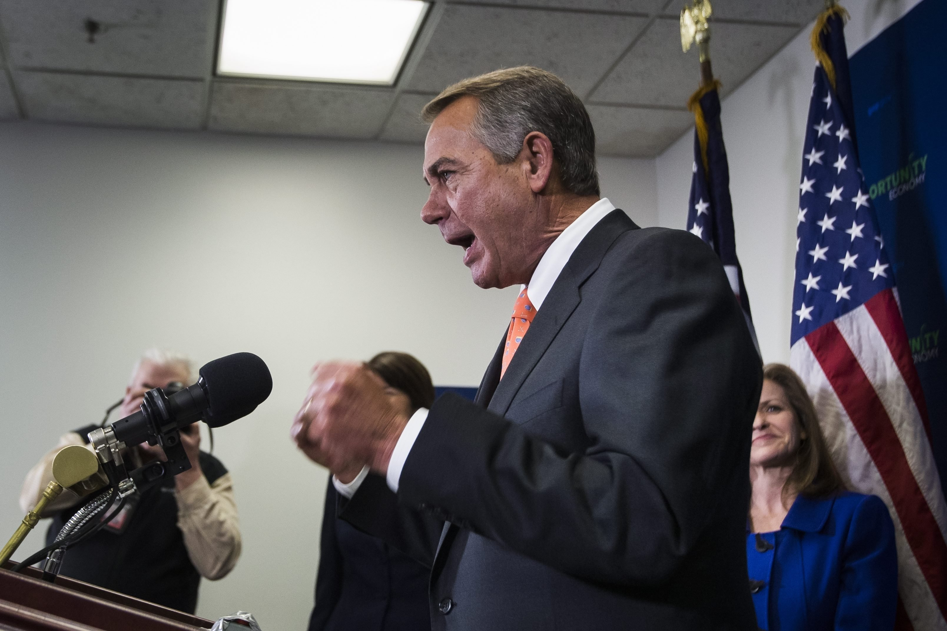 Republican Speaker of the House John Boehner speaks at a press conference about Obama's proposal seeking war authorization from congress to fight ISIS and the congressional vote on the Keystone XL Pipeline in the Capitol in Washington on Feb. 11, 2015.