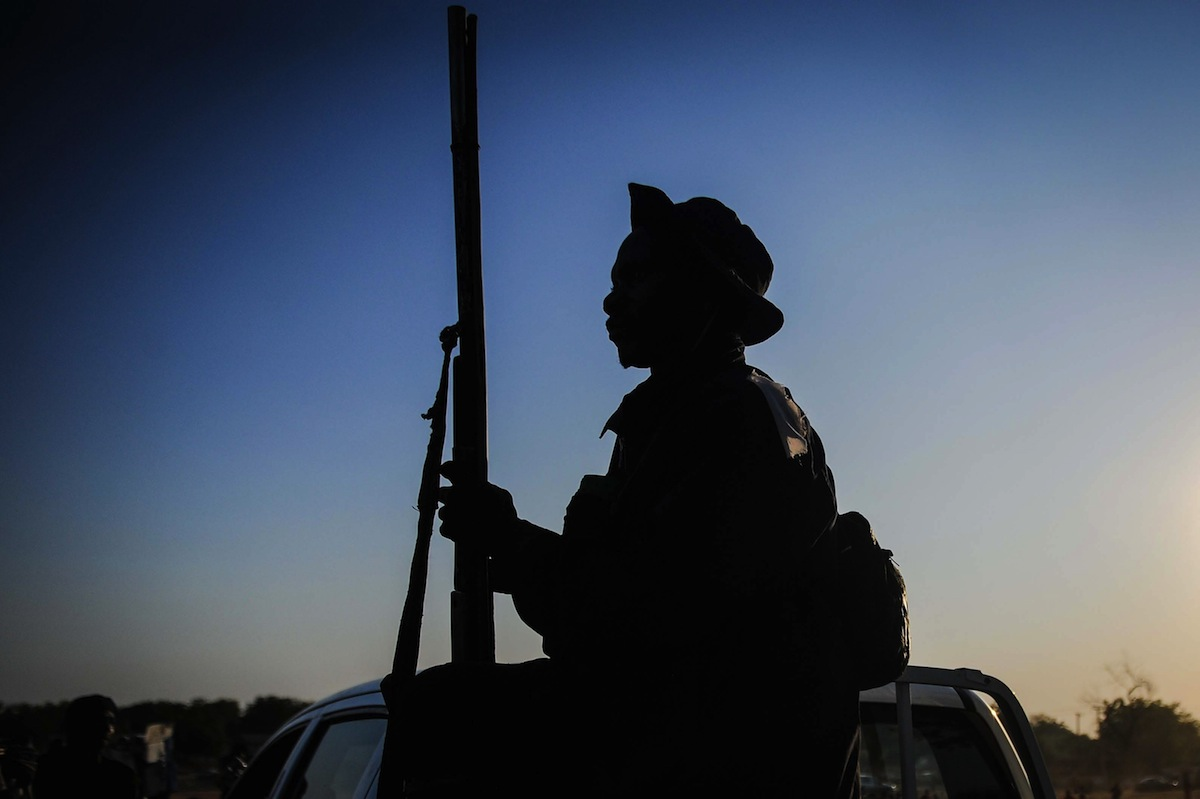 A local hunter armed with a gun is seen on a pick up truck in Yola city of Adamawa State in Nigeria before he moves to the border region between Nigeria and Cameroon to support the Nigerian army in fighting with Boko Haram militants on Dec. 06, 2014.