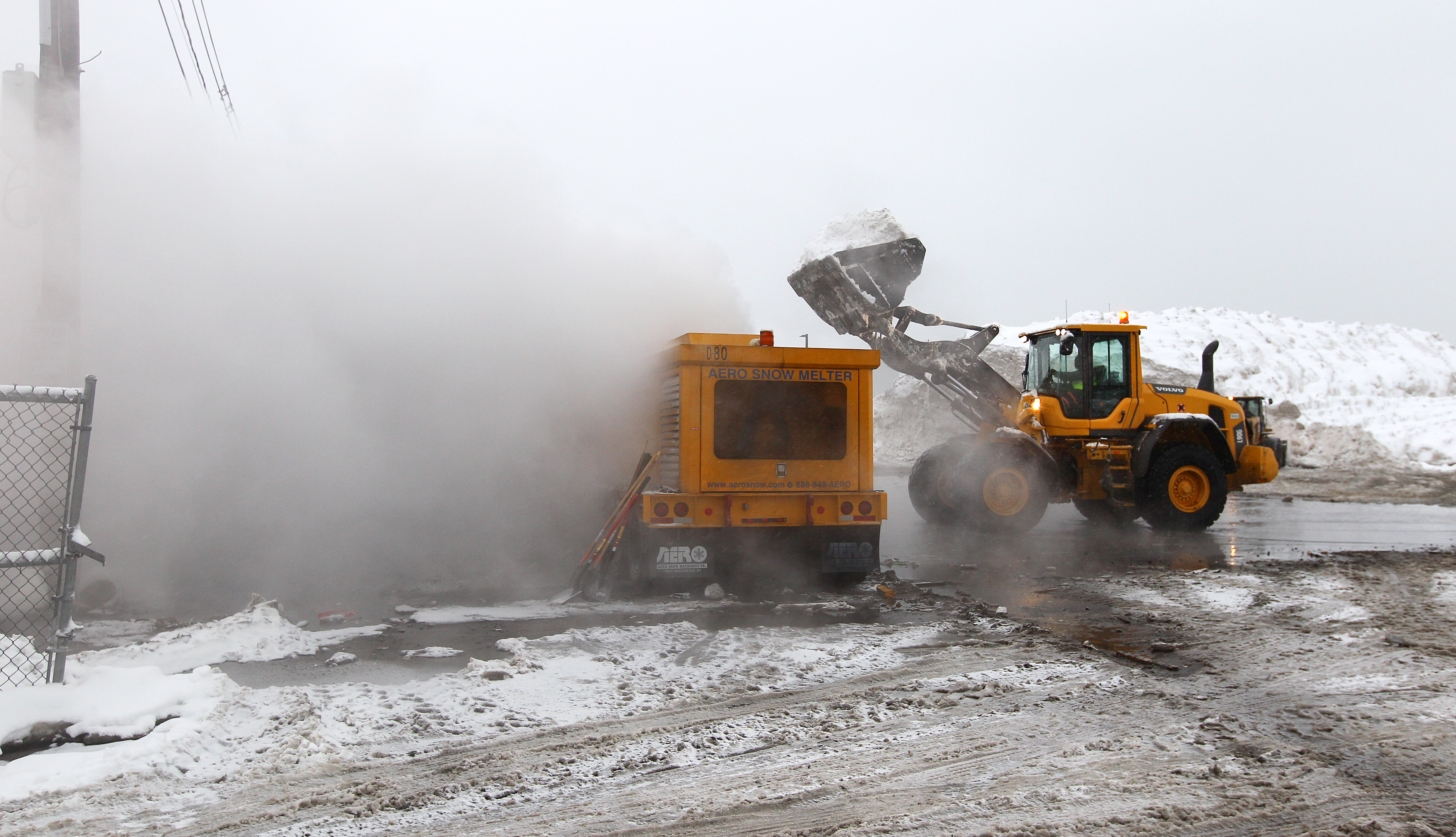 Crews use an Aero Snow Melter to dispatch mounds of snow at the Marine Industrial Park snow farm on Feb. 8, 2015.