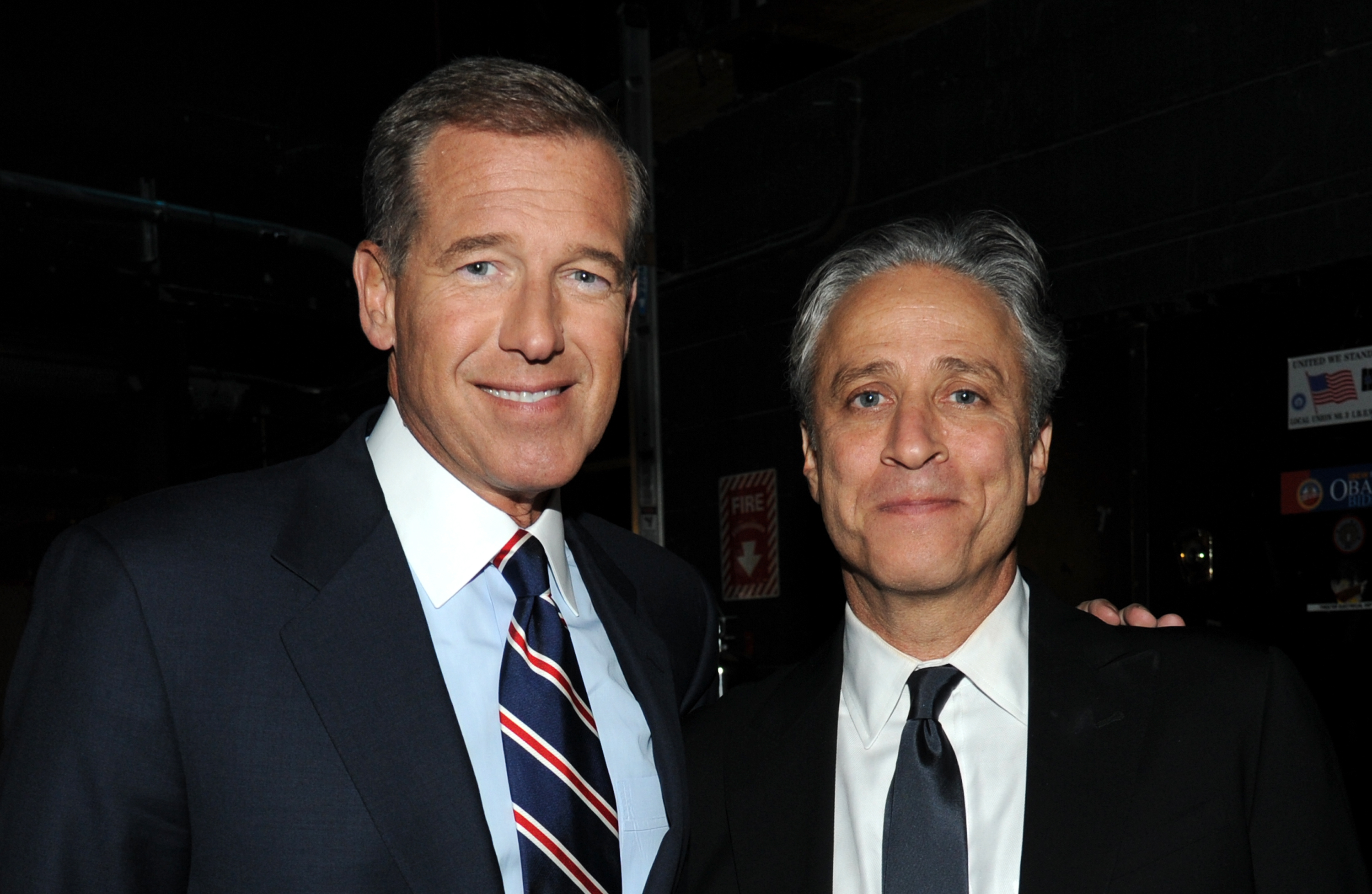Brian Williams and Jon Stewart backstage at The New York Comedy Festival And The Bob Woodruff Foundation Present The 7th Annual Stand Up For Heroes Event at Madison Square Garden on Nov. 6, 2013 in New York City.