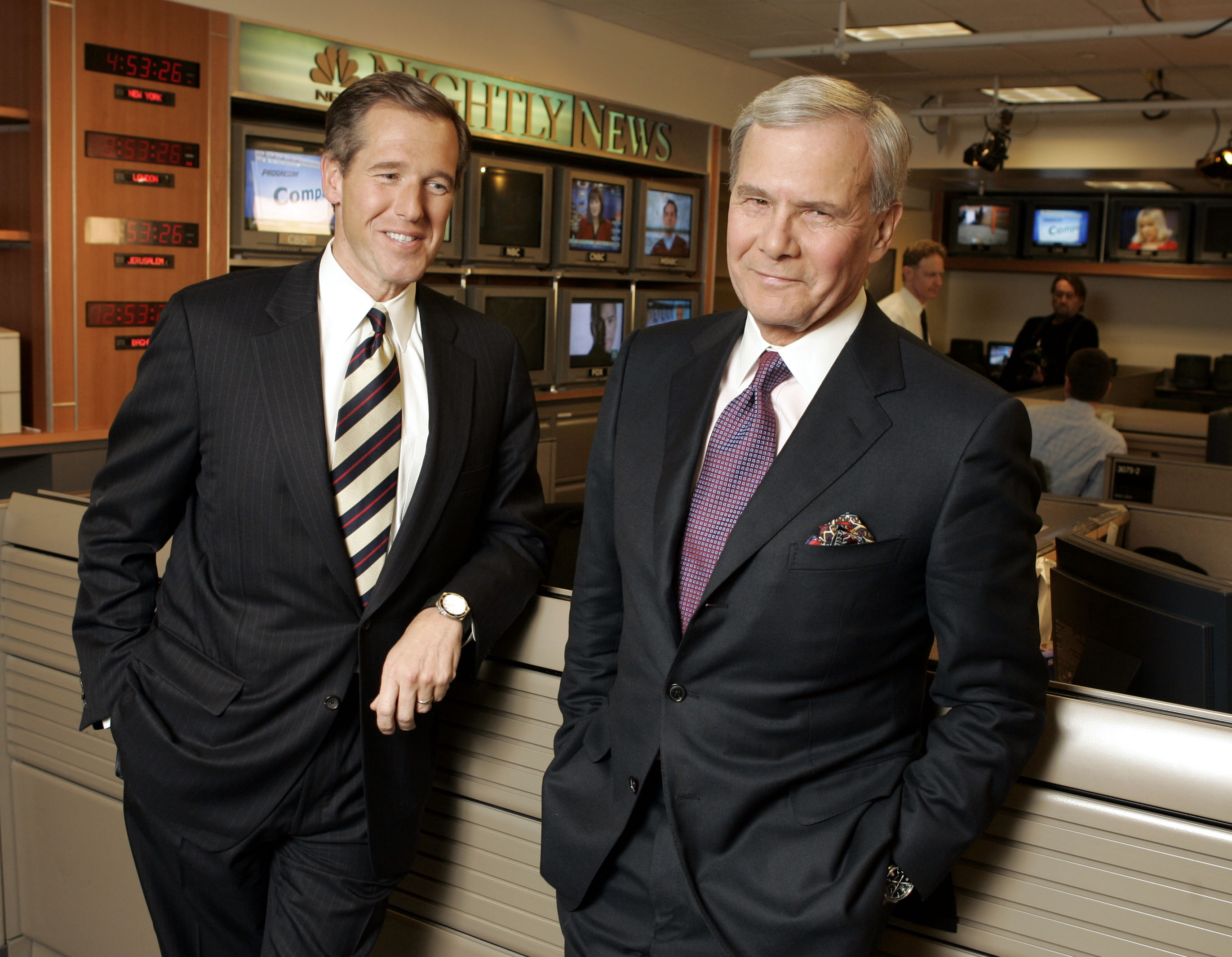 From Left: Brian Williams poses with NBC Anchor Tom Brokaw in New York City prior to Brokaw's last broadcast on Dec. 1, 2004.
