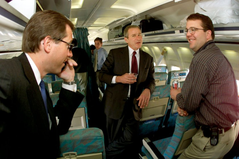 GEORGE W. BUSH SPEAKS WITH MEDIA MEMBERS ABOARD HIS CAMPAIGN PLANE.