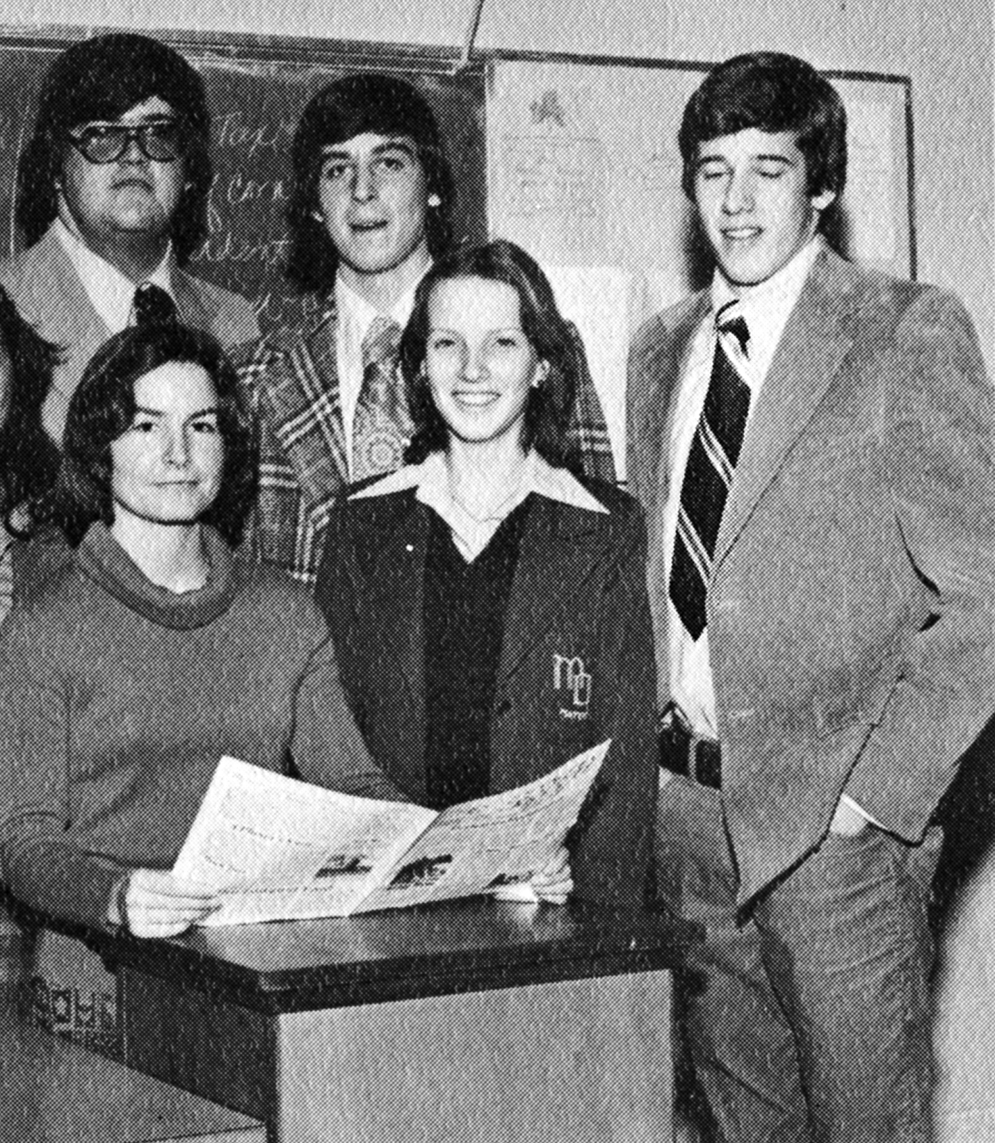 Brian Williams was the Editorial Editor for his  school newspaper seen here on the far right during his Senior Year at                                Mater Dei High School in New Monmouth, N.J. in 1977.