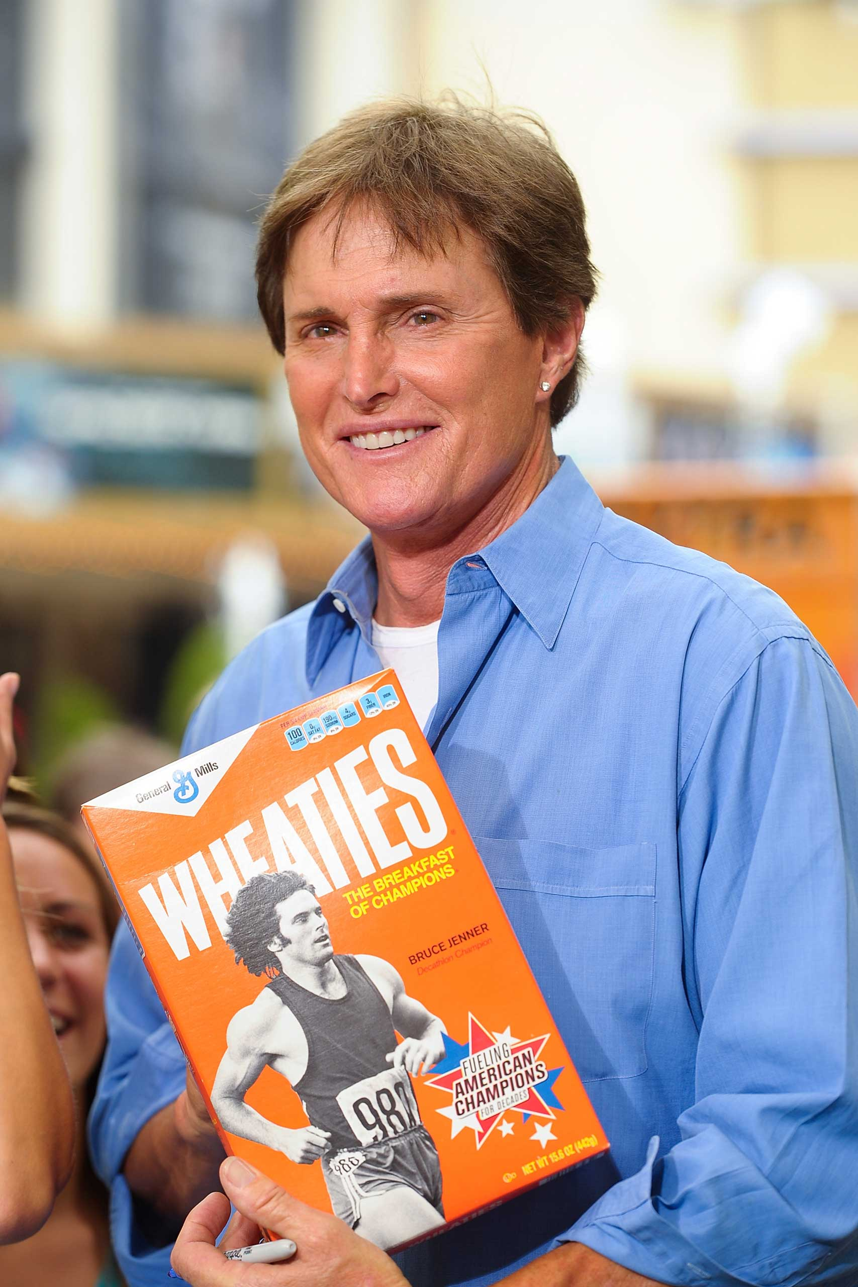 Jenner poses with a box of Wheaties in 2012. He appeared on the front of the box first in 1977 after his Olympic gold-medal win, then in 2012 when Wheaties rolled out a retro series.