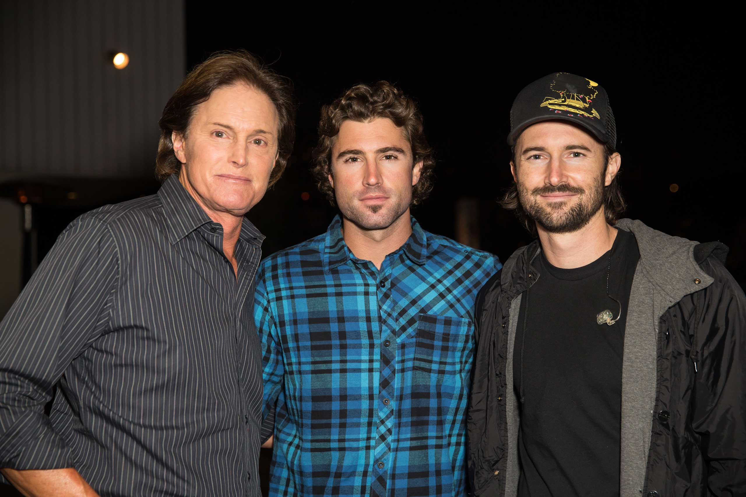 Jenner appears with two of his sons, TV personality Brody Jenner and musician Brandon Jenner, who records with his wife as Brandon & Leah, at an April 2013 release party.