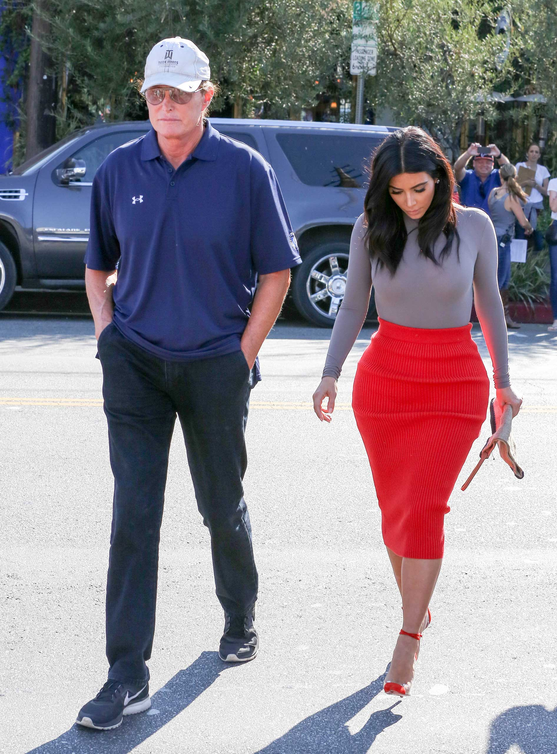 Jenner walks with step-daughter Kim Kardashian in October of 2014 — about five months after rapper Kanye West became his son-in-law.