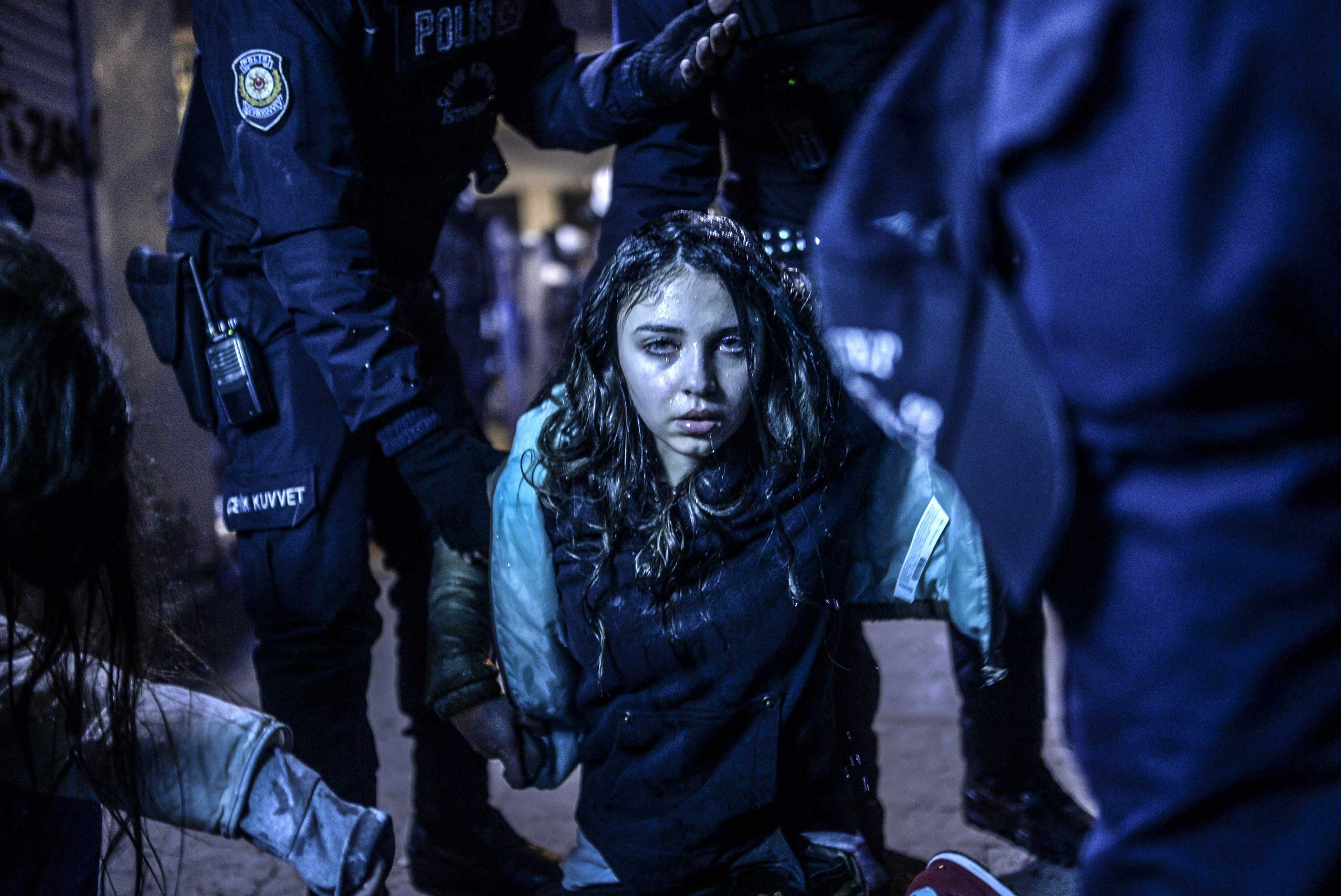 A young girl is pictured after she was  wounded during clashes between riot-police and protesters in Istanbul on March 12, 2014.