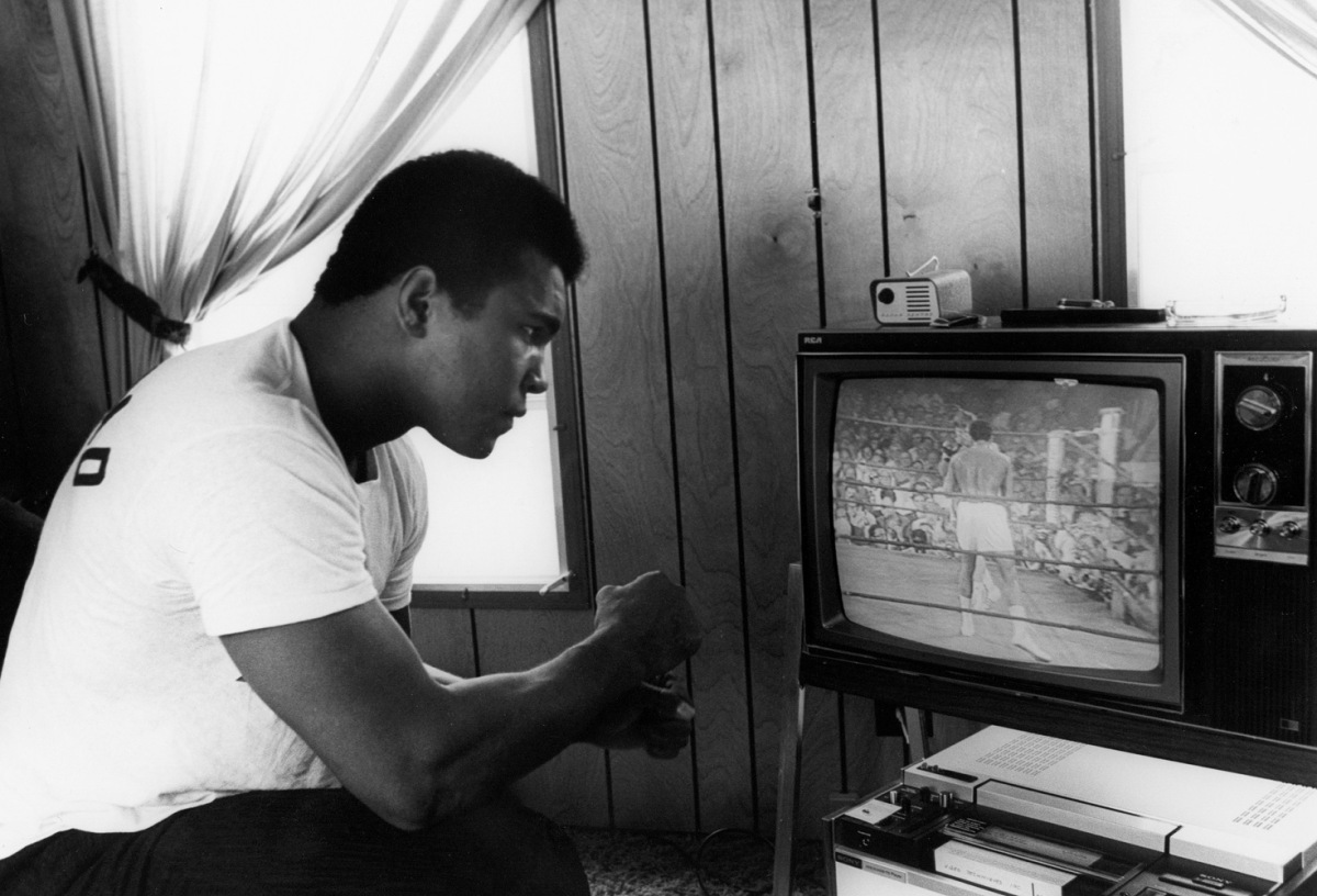 """Ali at his training camp in Pennsylvania, 1978Dr. Harry Edwards:  """"As a 1960s sports activist, I stood in profound awe and admiration of Muhammad Ali as he steadfastly risked everything in deference to his religious beliefs and political convictions. For me and millions around the world, his courage and commitment elevated him from the greatest boxer of his era to a transcendent and enduring cultural hero and icon whose life and contributions helped define the character of a generation both within and beyond the sports arena. It has been an honor and a privilege to know him.""""                               Dr. Harry Edwards is a sociologist whose work focuses on the experiences of African-American athletes. He is a professor emeritus at the University of California, Berkeley."""