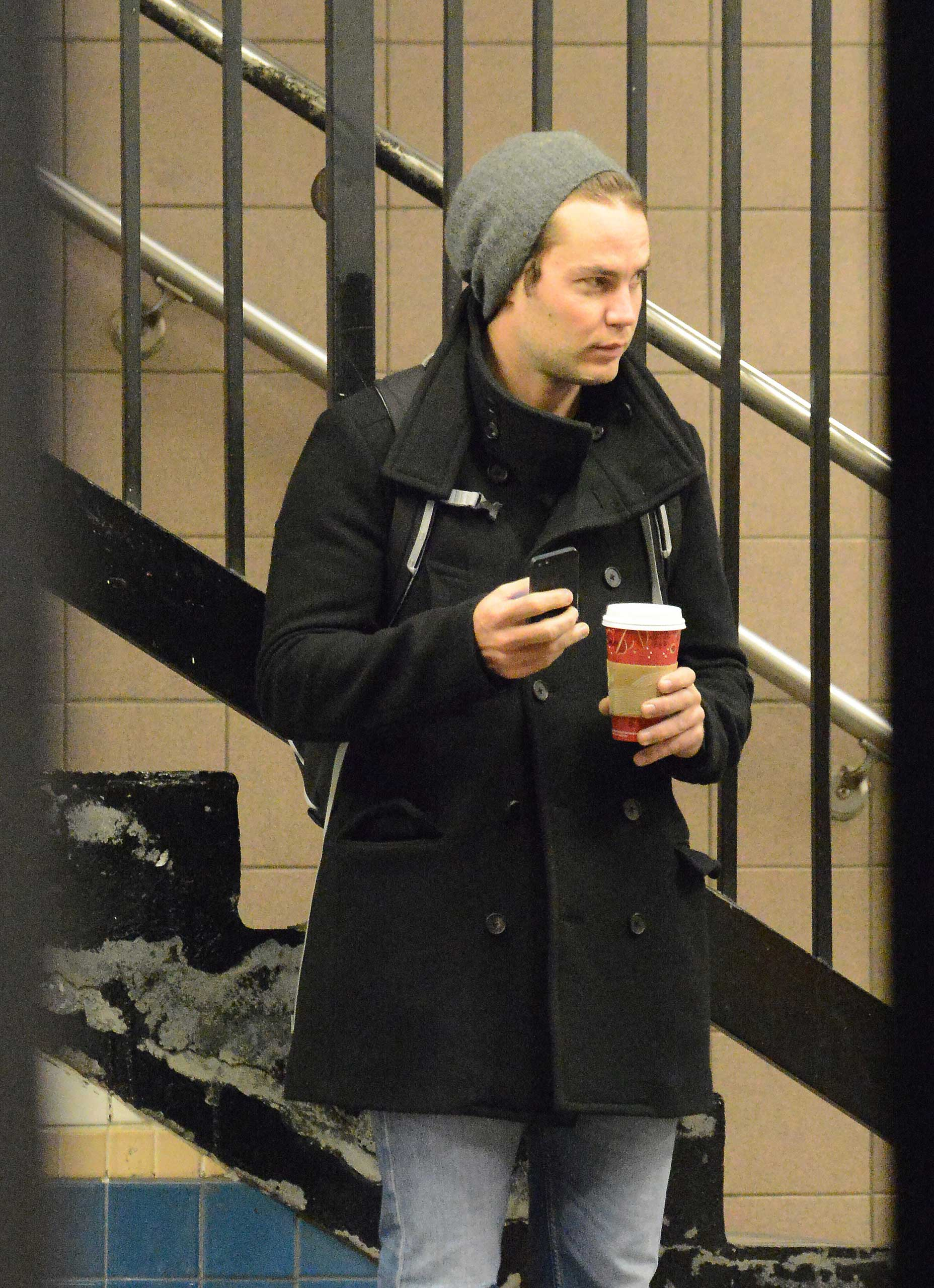 Taylor Kitsch walks to the subway and waits for a train in New York City on Nov. 15, 2014.