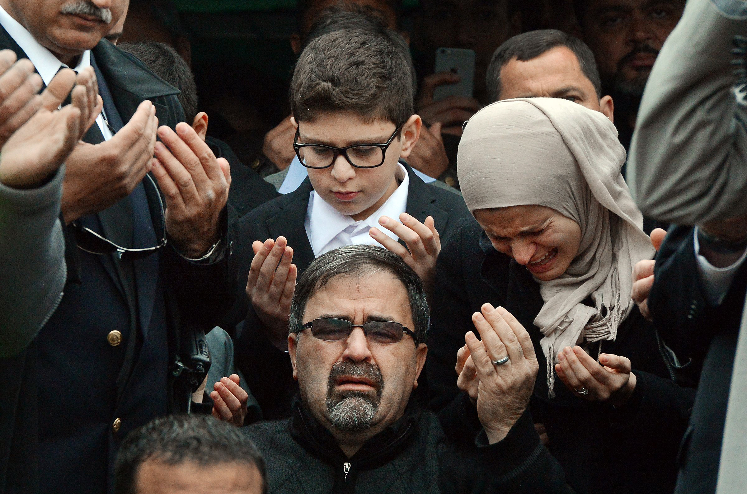 Namee Barakat, center, watches during funeral services for his son Deah Barakat in Wendell, N.C., on Feb. 12, 2015