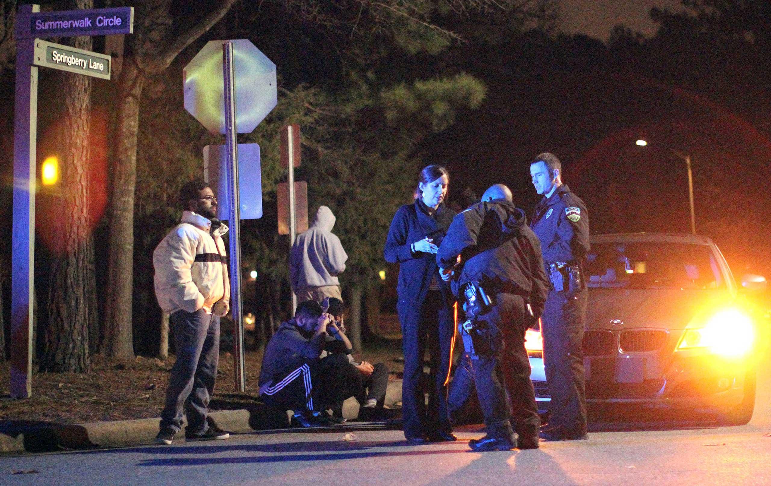 Chapel Hill police officers investigate the scene of three murders near Summerwalk Circle in Chapel Hill, N.C., Feb. 10, 2015.