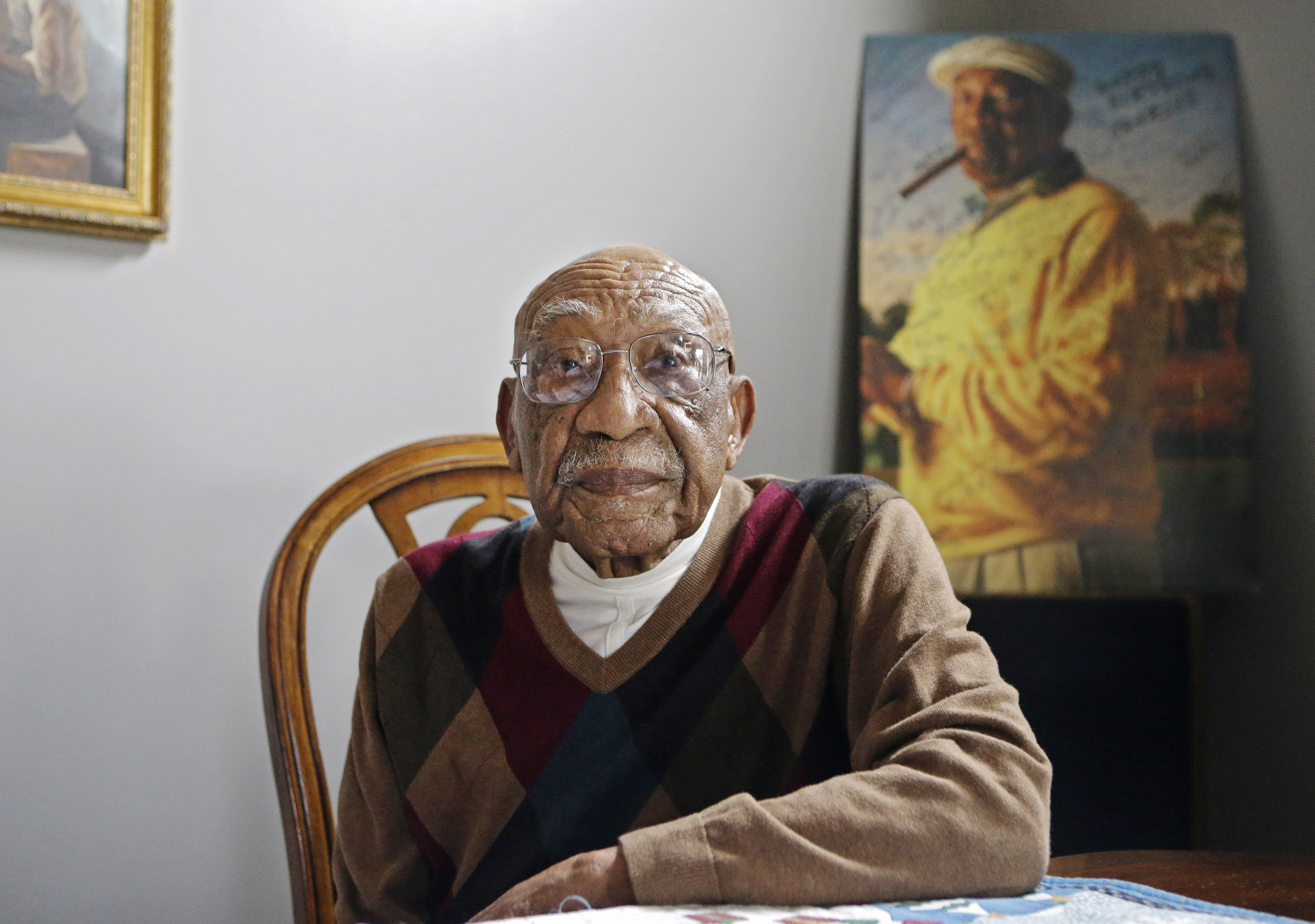 Former PGA golfer Charlie Sifford sits in the dining room of his home in Brecksville, Ohio on Nov. 13, 2014.