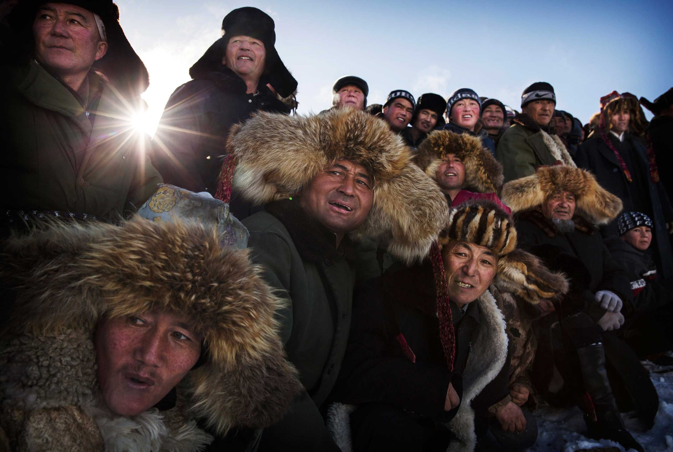 Spectators react as they watch a Chinese Kazakh eagle hunter release his bird during the competition.