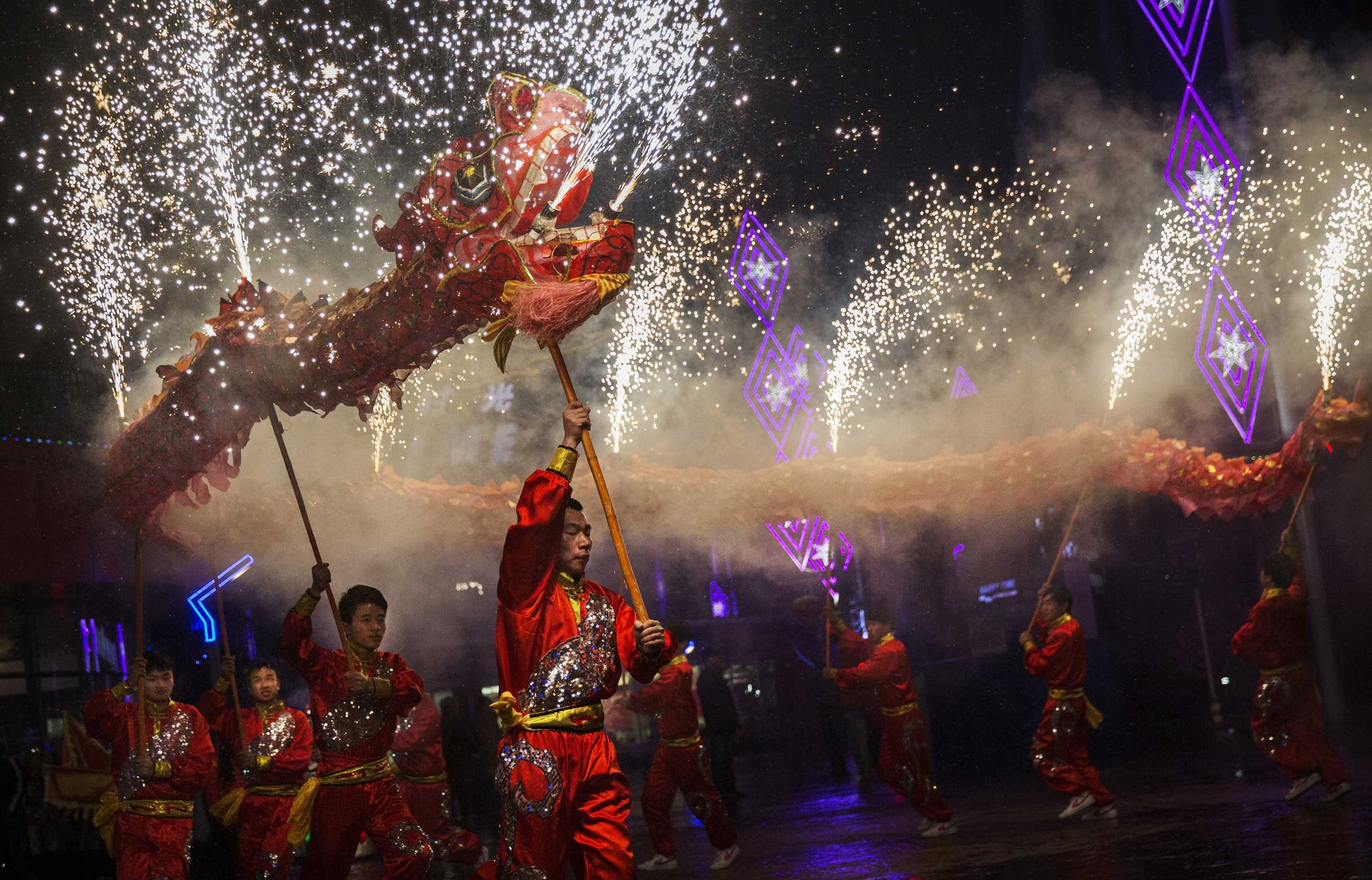 Artists perform a dragon dance at a local amusement park during celebrations for the Lunar New Year, Feb. 19, 2015 in Beijing.