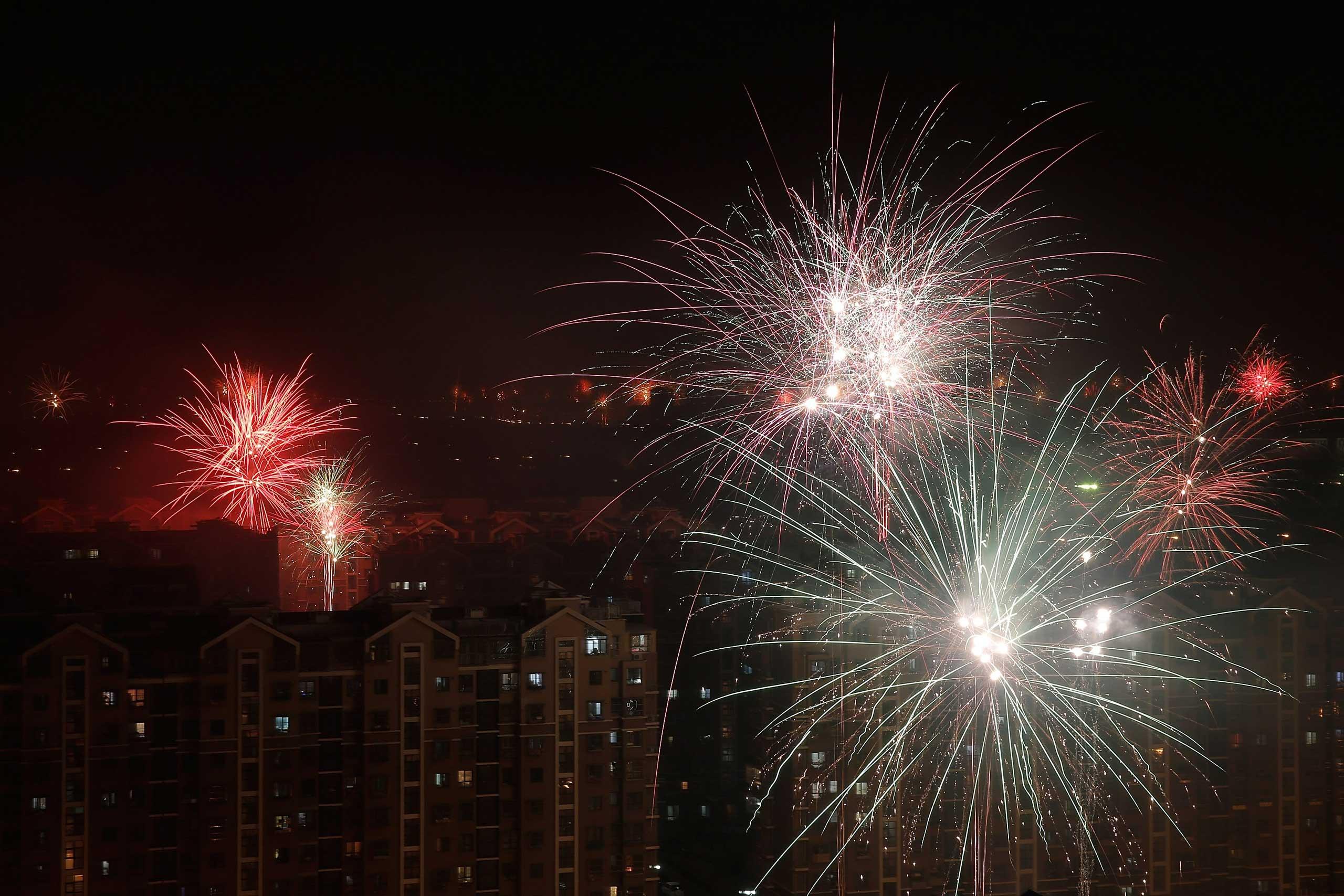 Fireworks illuminate the skyline to celebrate Lunar New Year on Feb. 18, 2015 in Beijing.