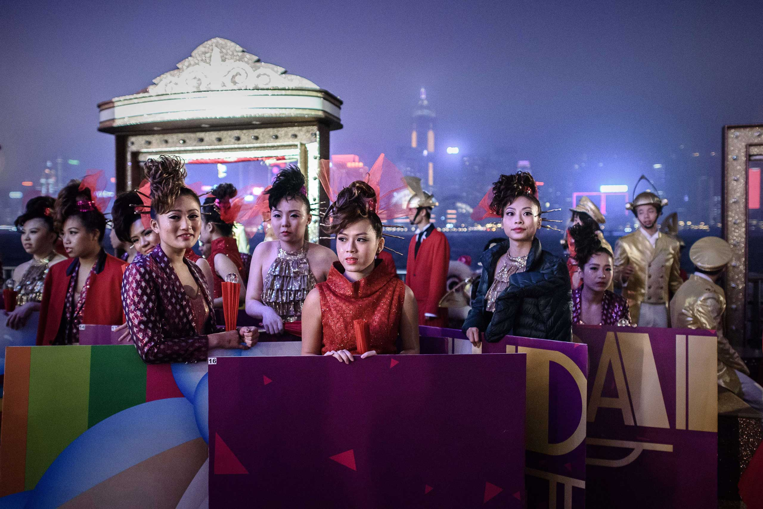 Performers wait for the start of the celebrations of the Lunar New Year in Hong Kong on Feb. 19, 2015.