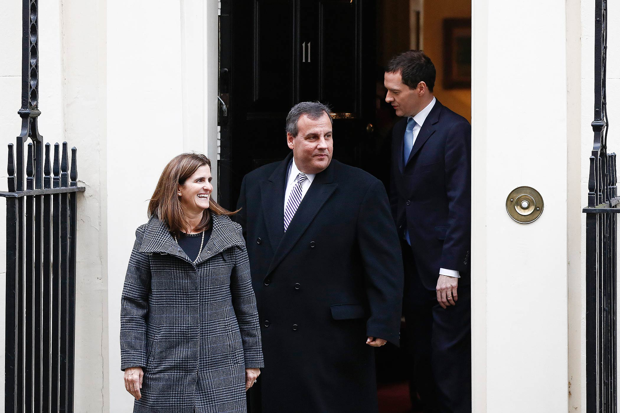 British Chancellor of the Exchequer George Osborne, right, follows Chris Christie, governor of New Jersey, center, and his wife Mary Pat Christie, out of 11 Downing Street following their meeting in London, U.K., on Feb. 3, 2015.