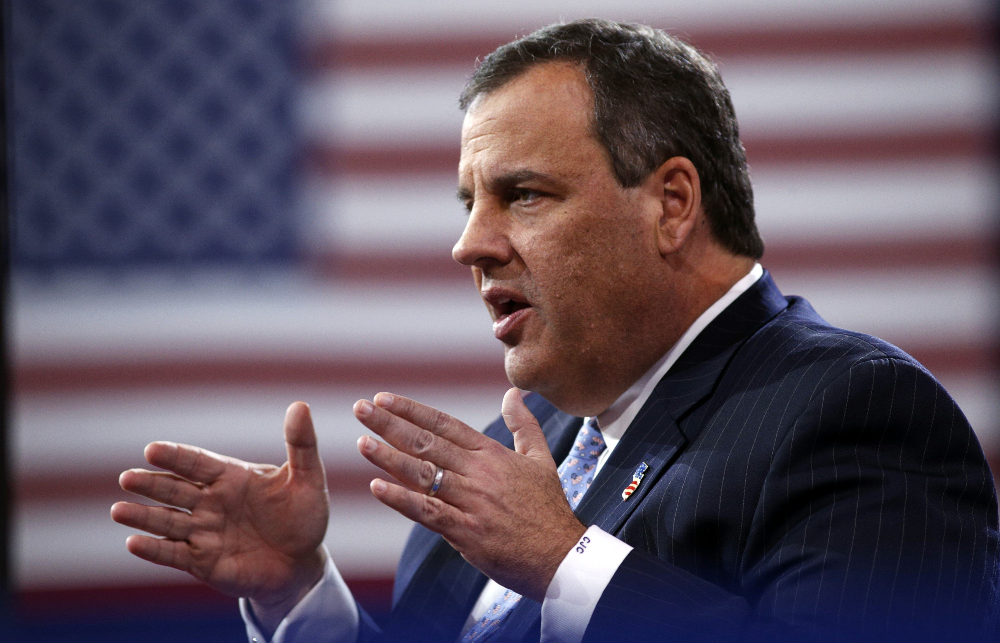 New Jersey Governor Christie speaks while being interviewed onstage at the Conservative Political Action Conference (CPAC) at National Harbor in Maryland