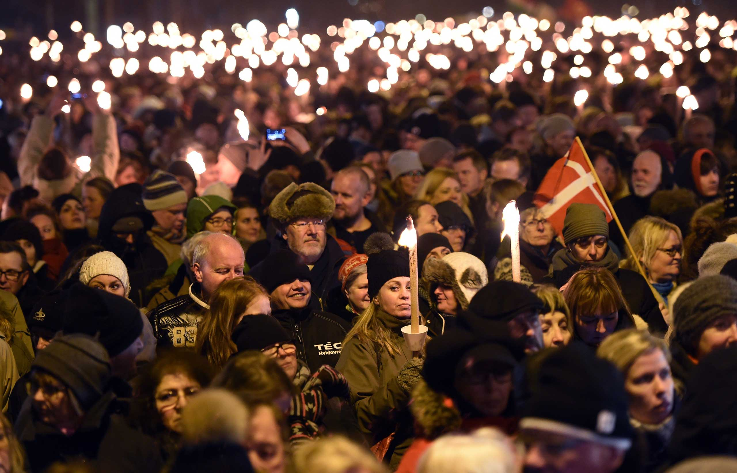 People attend a memorial service held for those killed on by a 22-year-old gunman, in Copenhagen, Denmark, Feb. 16, 2015.