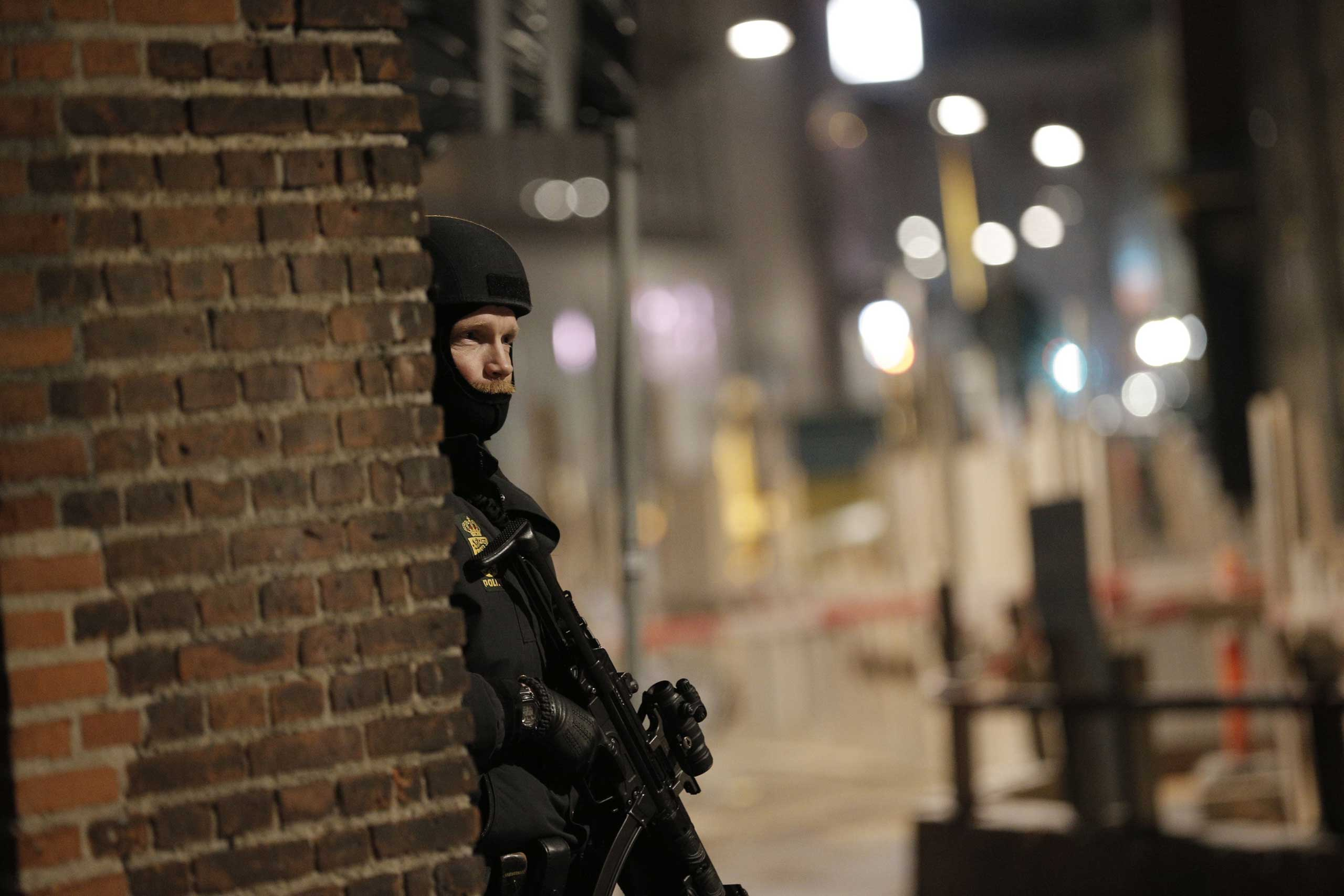 A police officer stands his post on the streets of central Copenhagen on Feb. 15, 2015.