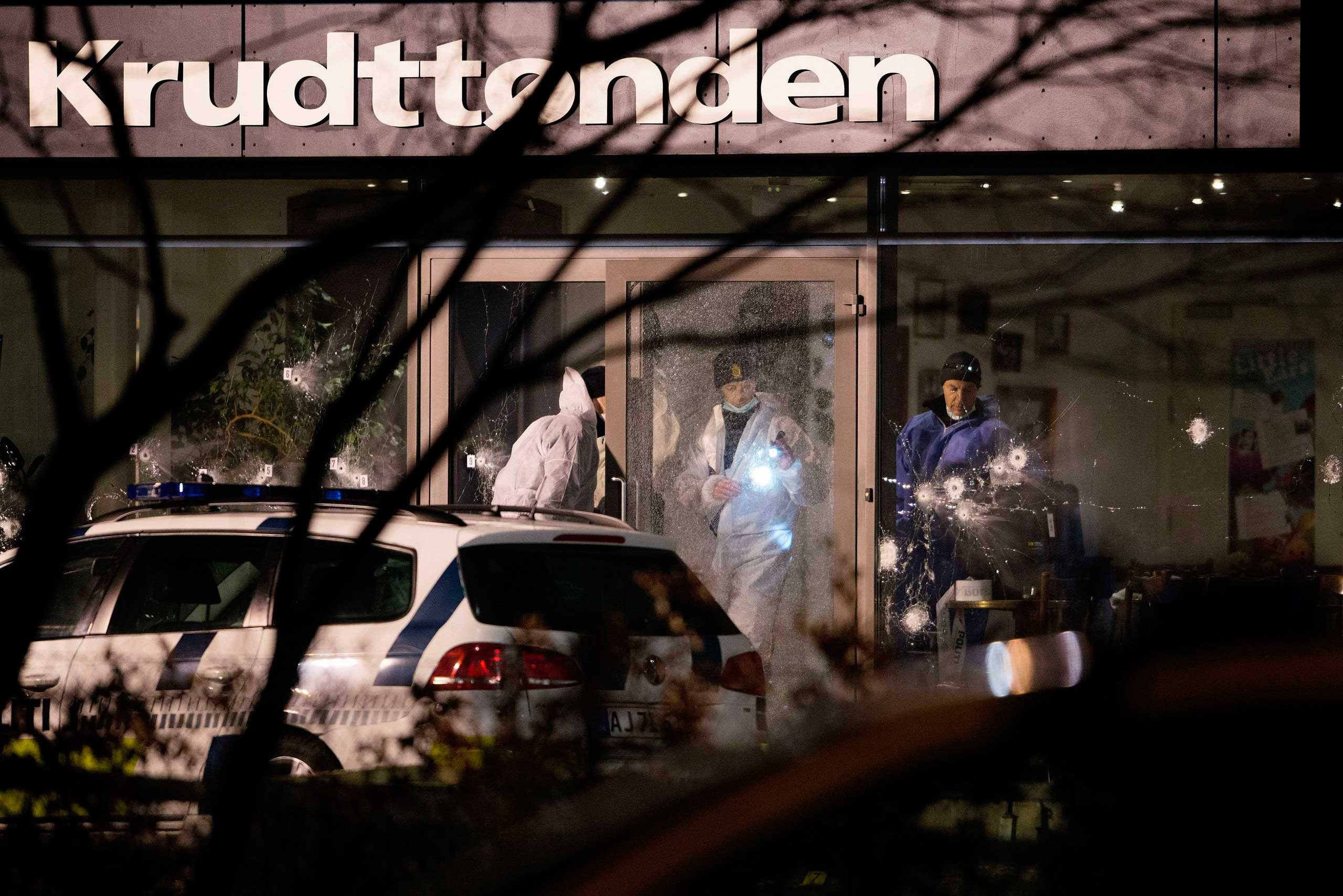 Forensic investigators are seen at the site of a shooting in Copenhagen, Feb. 14, 2015.