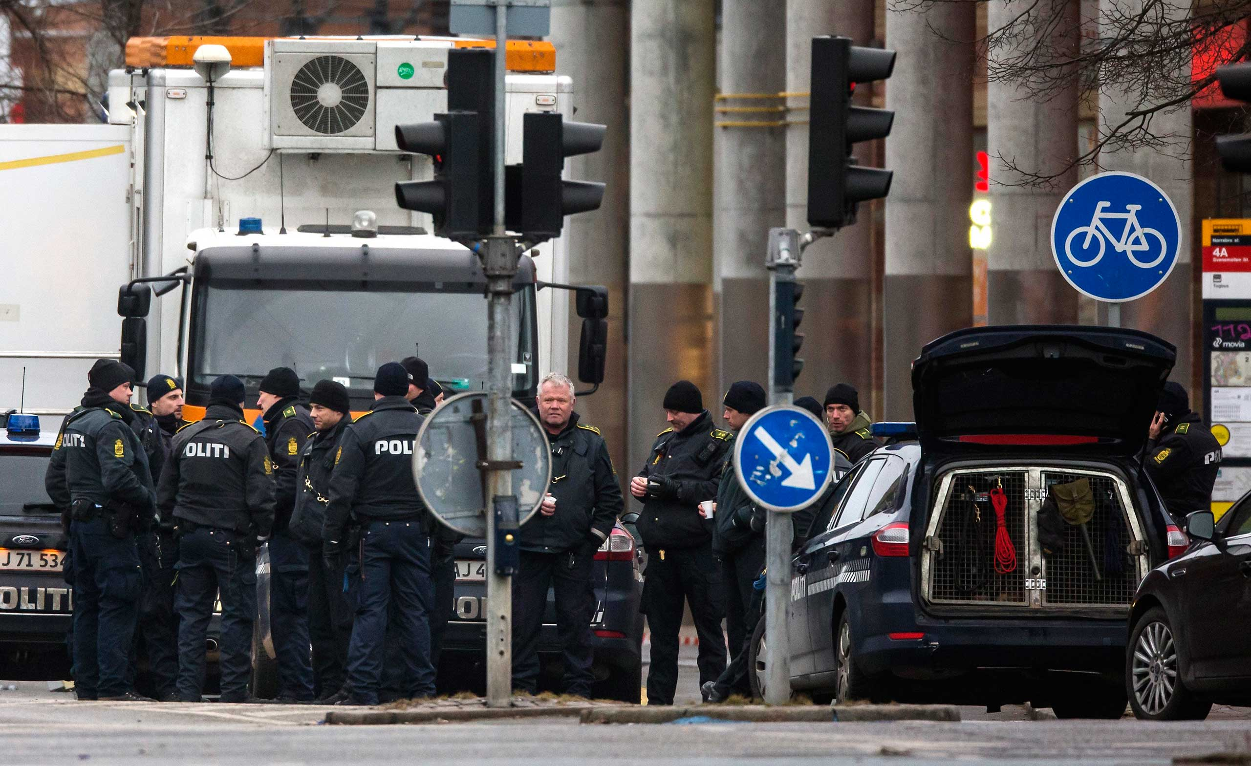 Police officers gather near the site where a man was killed by police, close to Norrebro Station, in Copenhagen, Feb. 15, 2015.