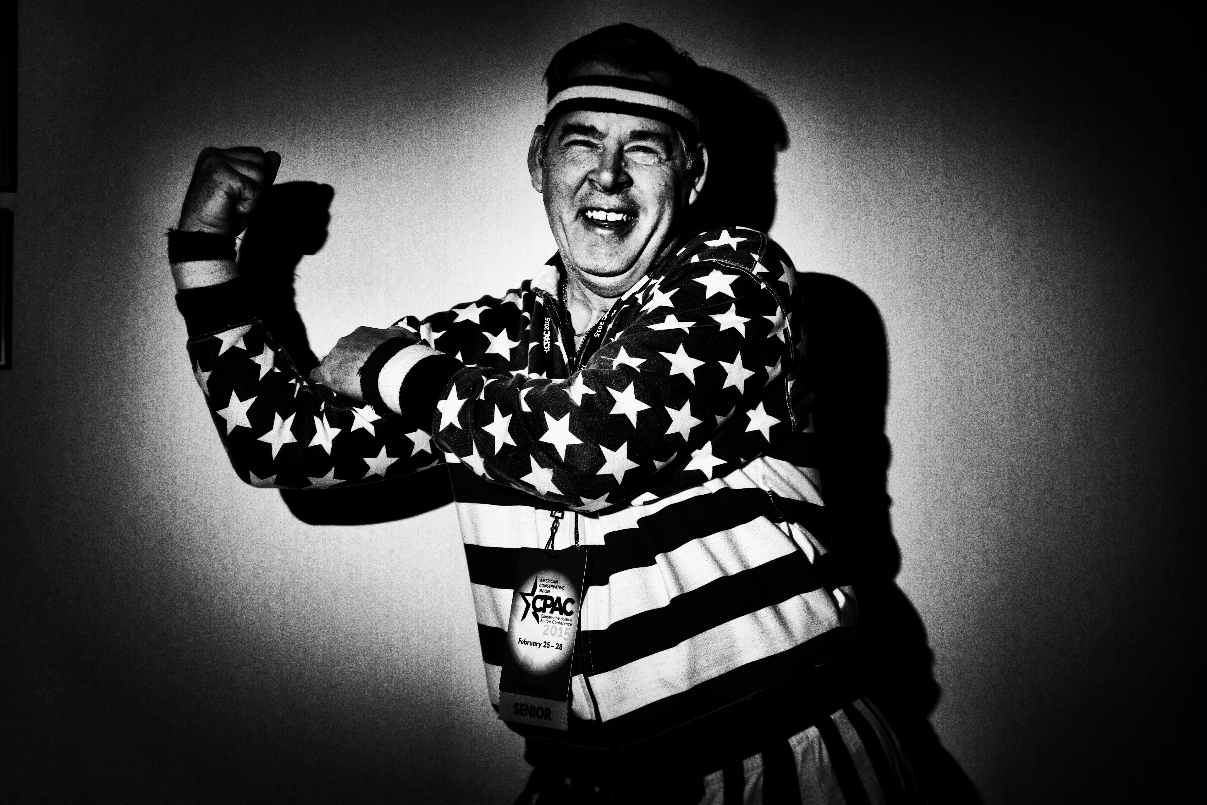 Timothy Flynn from New York City poses in an American flag jacket at CPAC in National Harbor, Md., on Feb. 26, 2015.