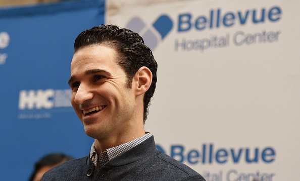 Dr. Craig Spencer smiles during a news conference November 11, 2014 at Bellevue Hospital in New York.