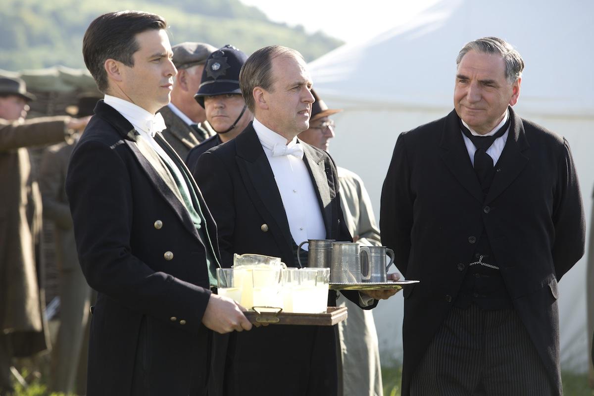 Robert James-Collier as Thomas (far left) on Downton Abbey