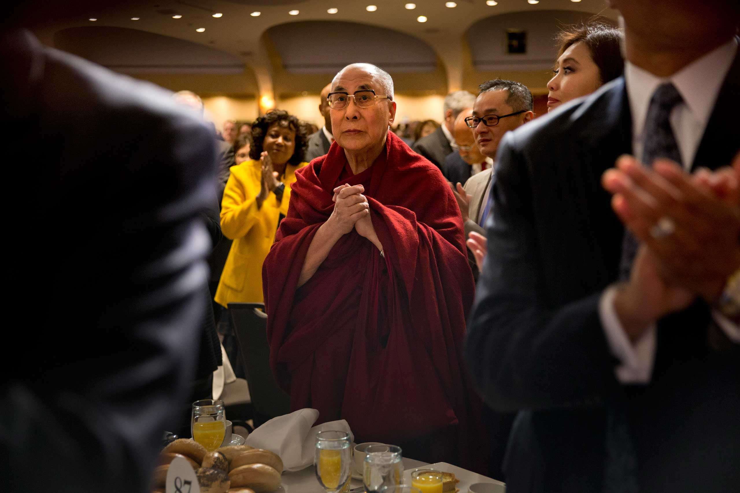 The Dalai Lama stands at the National Prayer Breakfast in Washington, D.C., in February 2015.