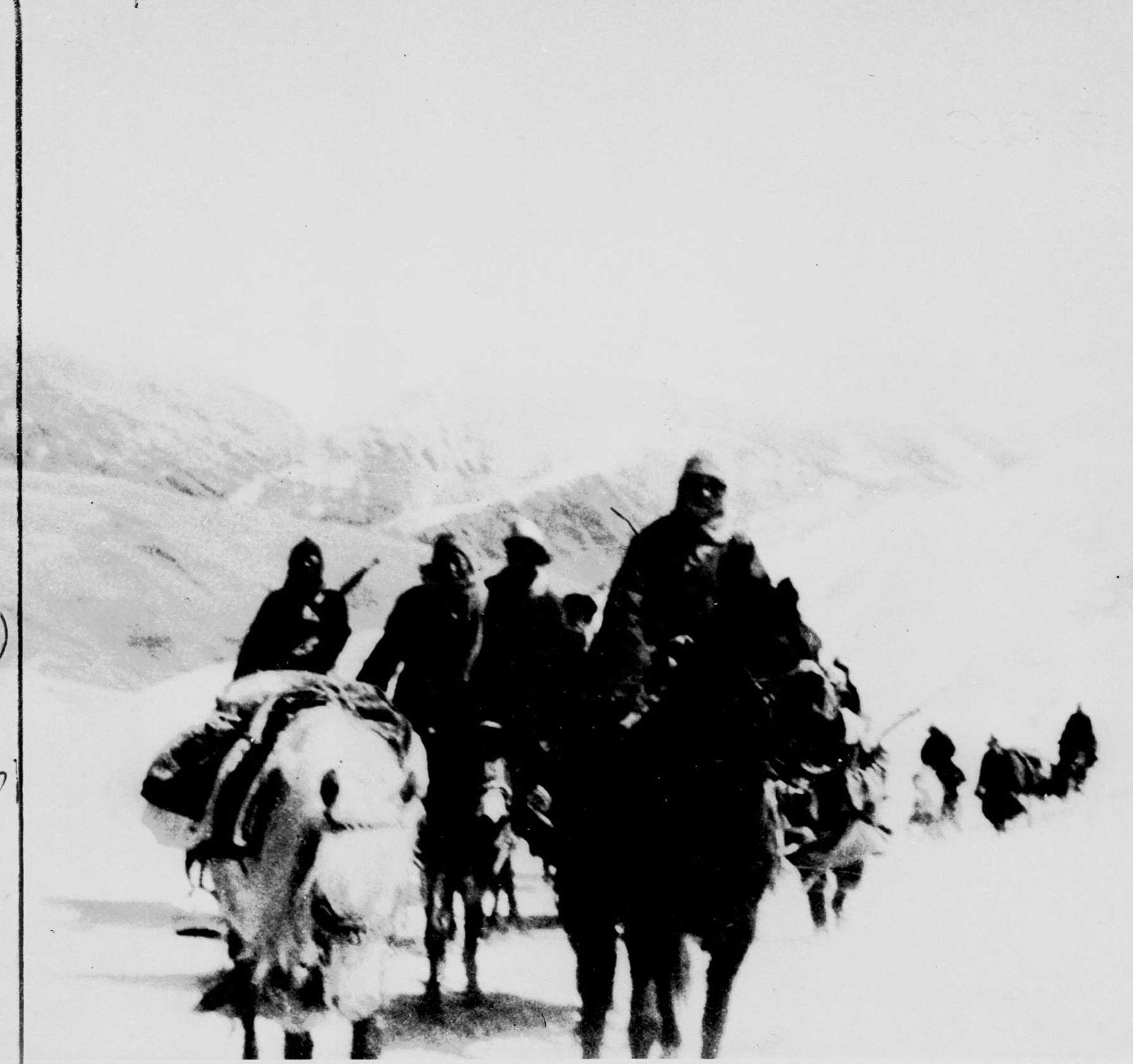 Averaging 12 miles a day through the Himalayas, the Dalai Lama is shown journeying through the Karpo Pass, one of the highest on the flight route of the 23-year-old ruler from Lhasa. His flight began on March 17, 1959. Here the escape party is seen on March 28, three days before reaching sanctuary in the free zone of India.