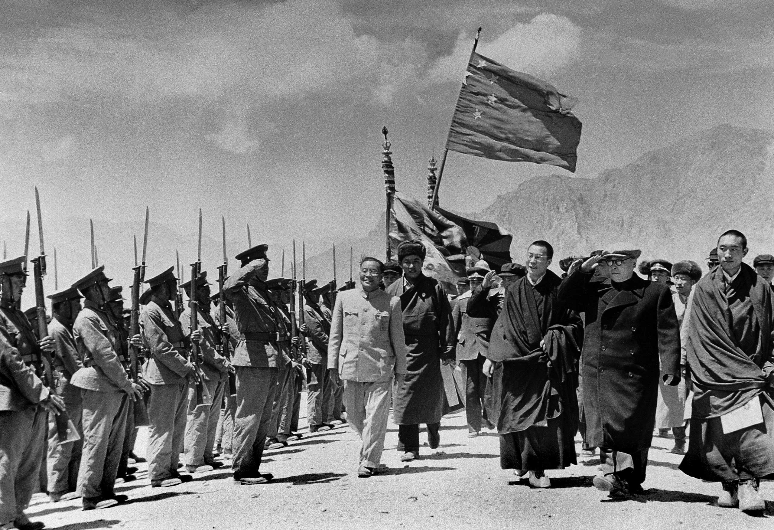 The Dalai Lama is seen with members of a Chinese government delegation on their official visit to Tibet in 1956.