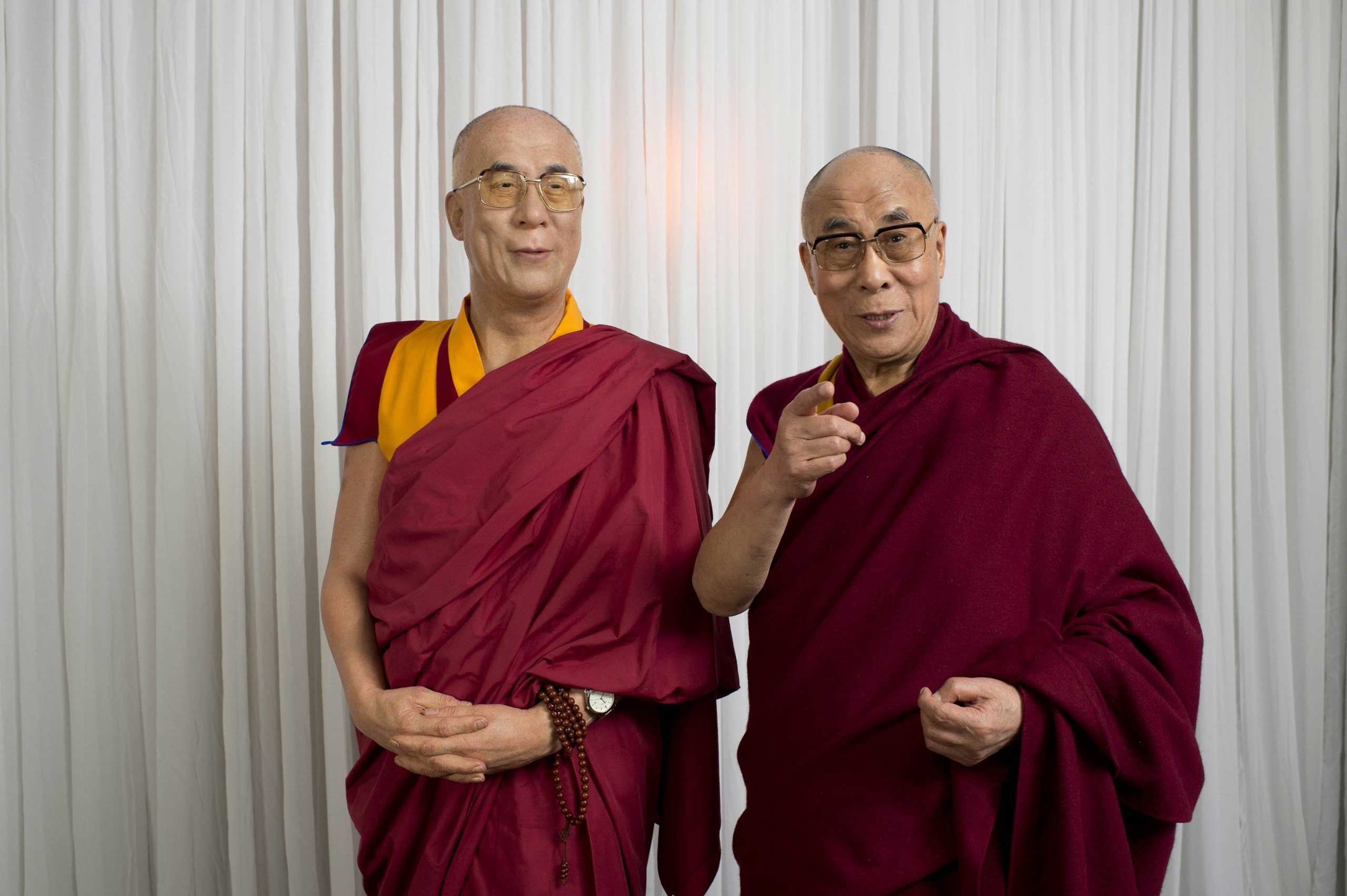 The Dalai Lama visits Madame Tussauds and poses with a wax figure of himself in Sydney in June 2013.