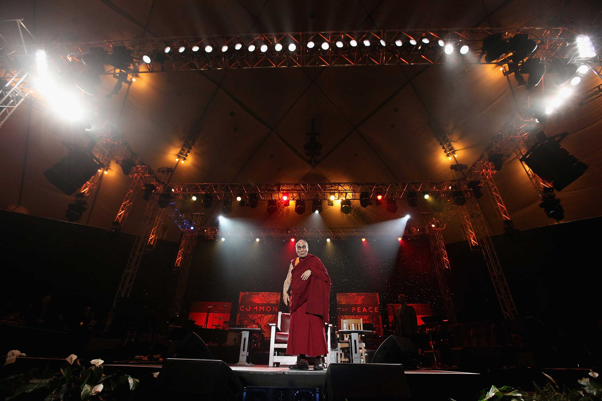 The Dalai Lama speaks onstage at the One World Concert at Syracuse University in New York in October 2012.